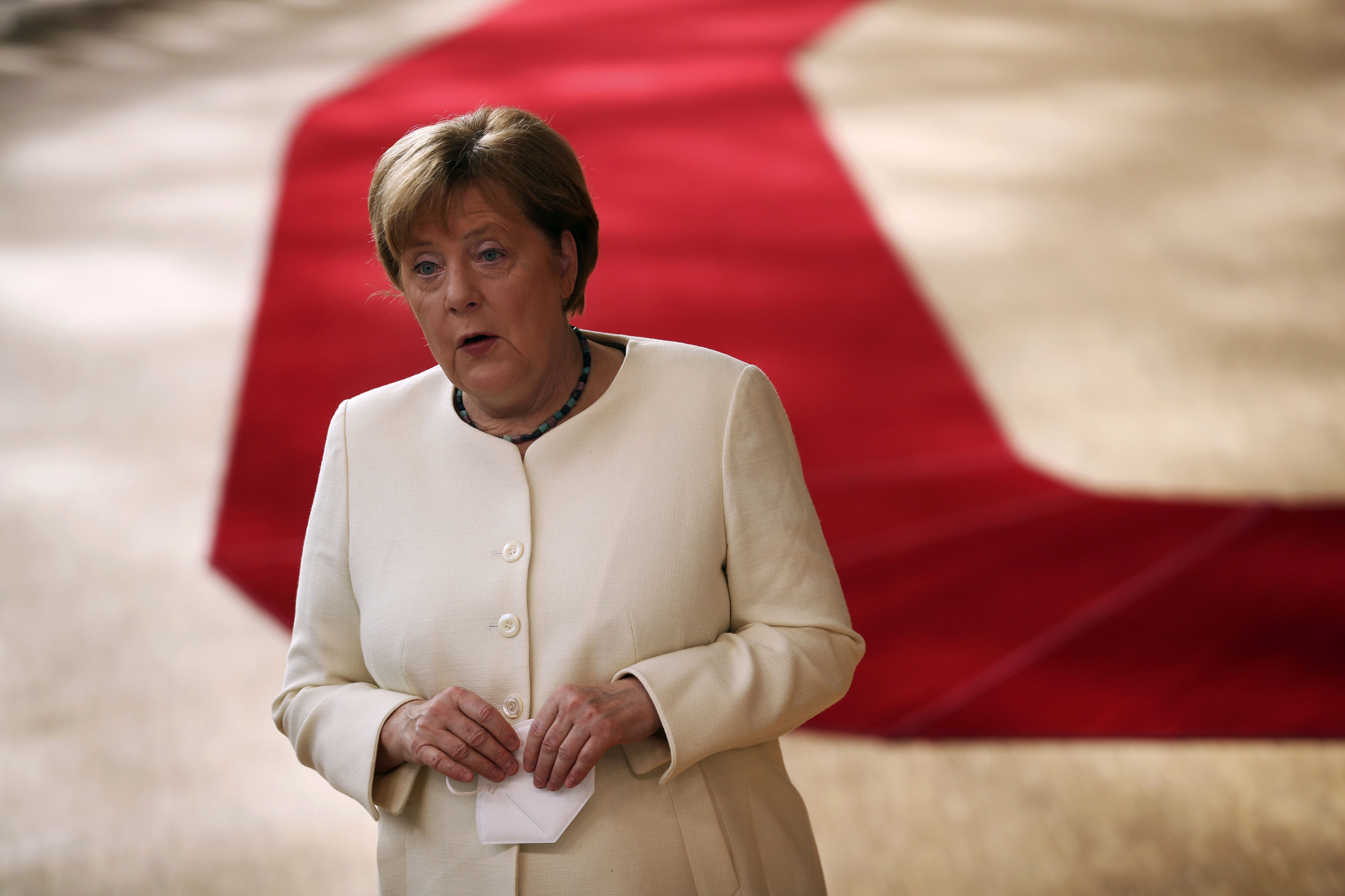 German Chancellor Angela Merkel makes a statement at the European Council building in Brussels, Belgium, on July 19.