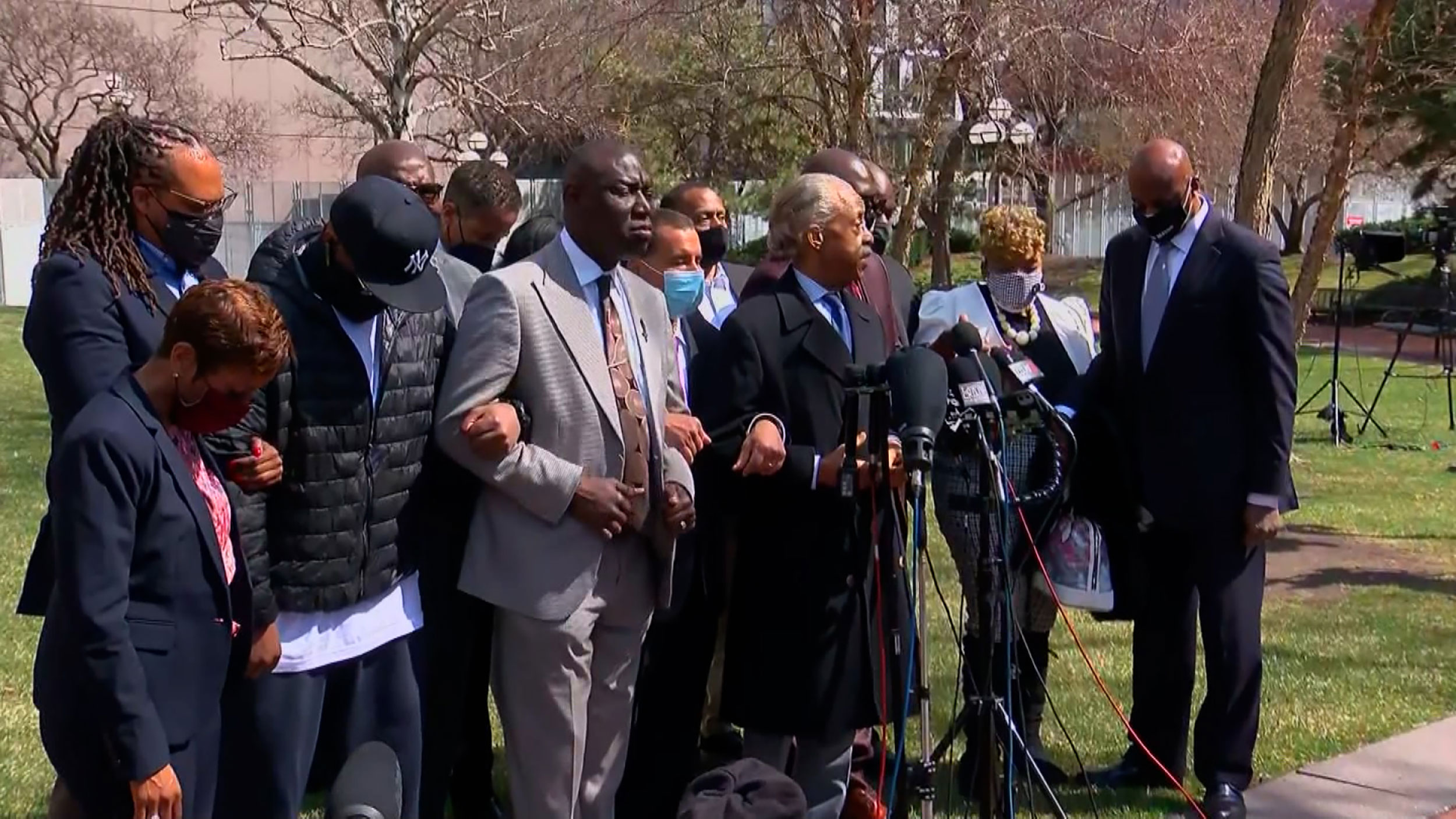 Rev. Al Sharpton leads a group prayer on Tuesday.