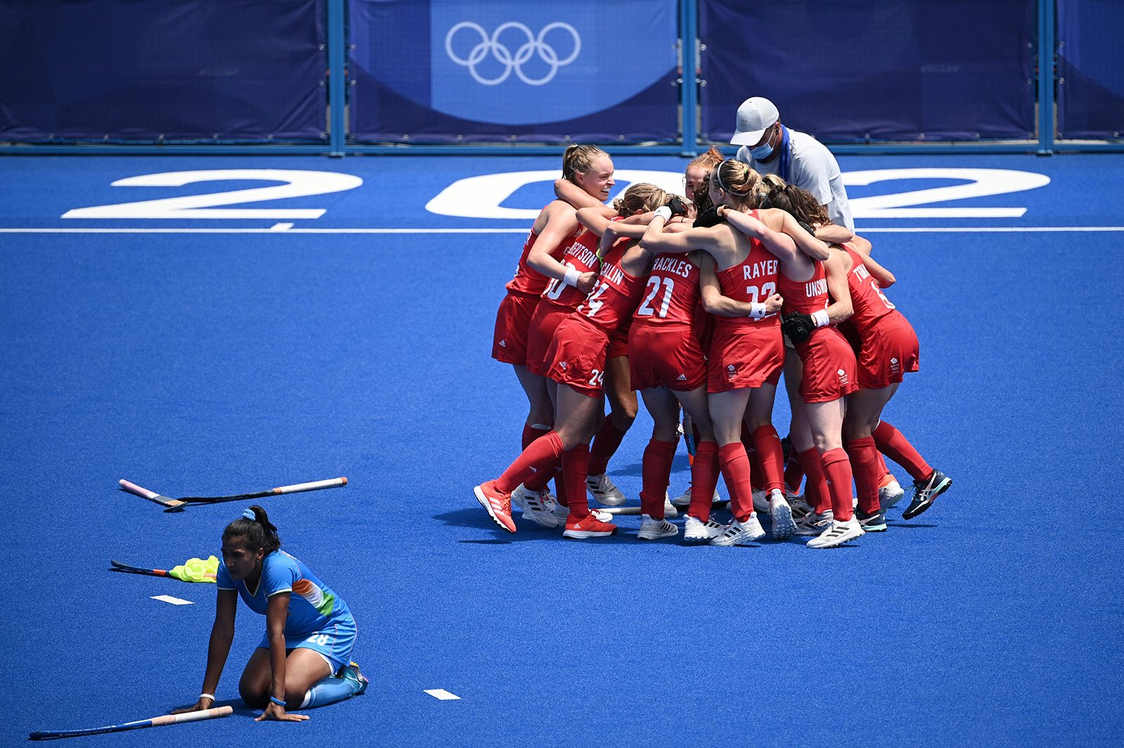 Great Britain's field hockey team celebrates after winning the women's bronze medal match by defeating India 4-3 on Friday.