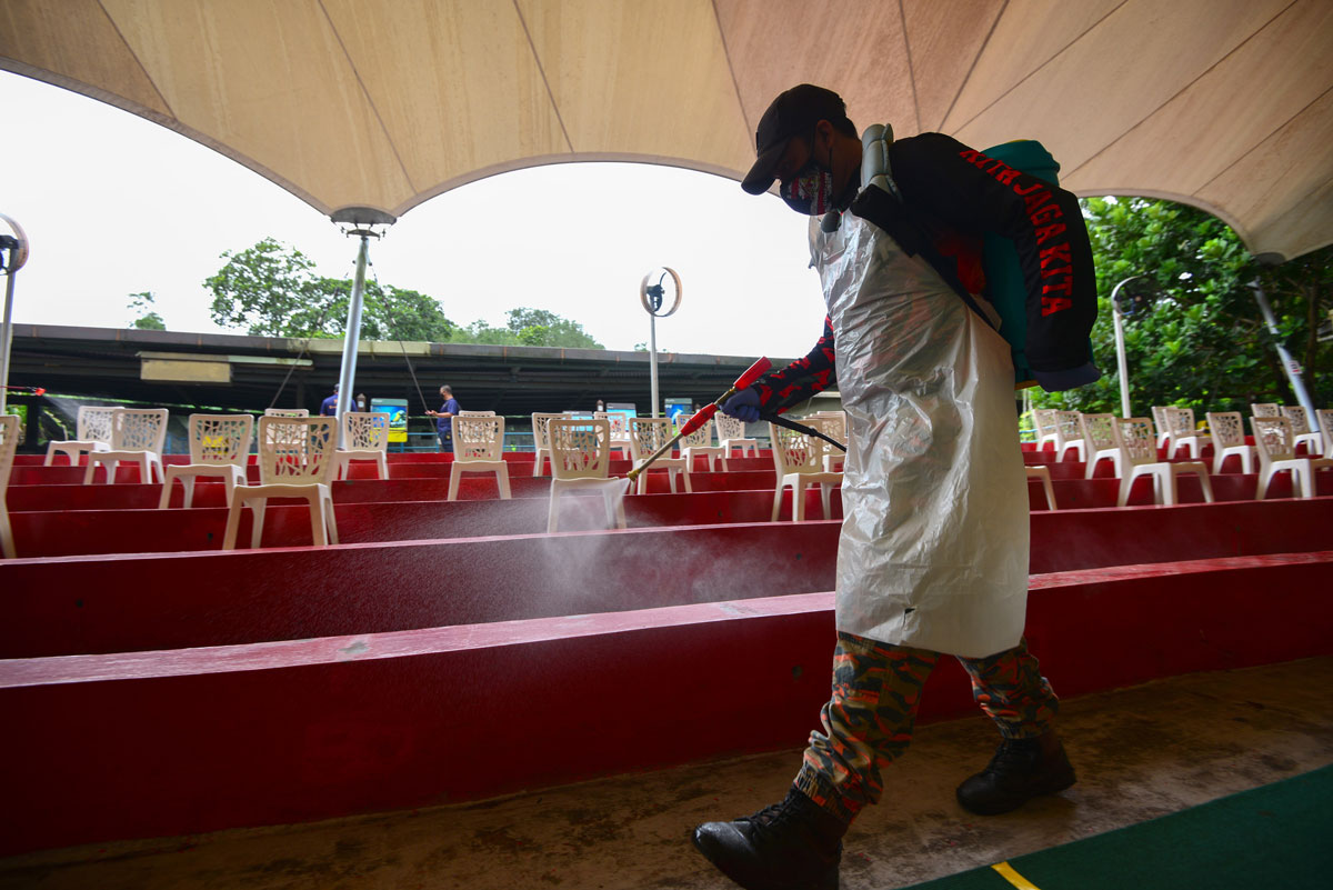 A fire and rescue department member helps disinfect the facilities at Zoo Negara, near Kuala Lumpur, Malaysia on December 19.