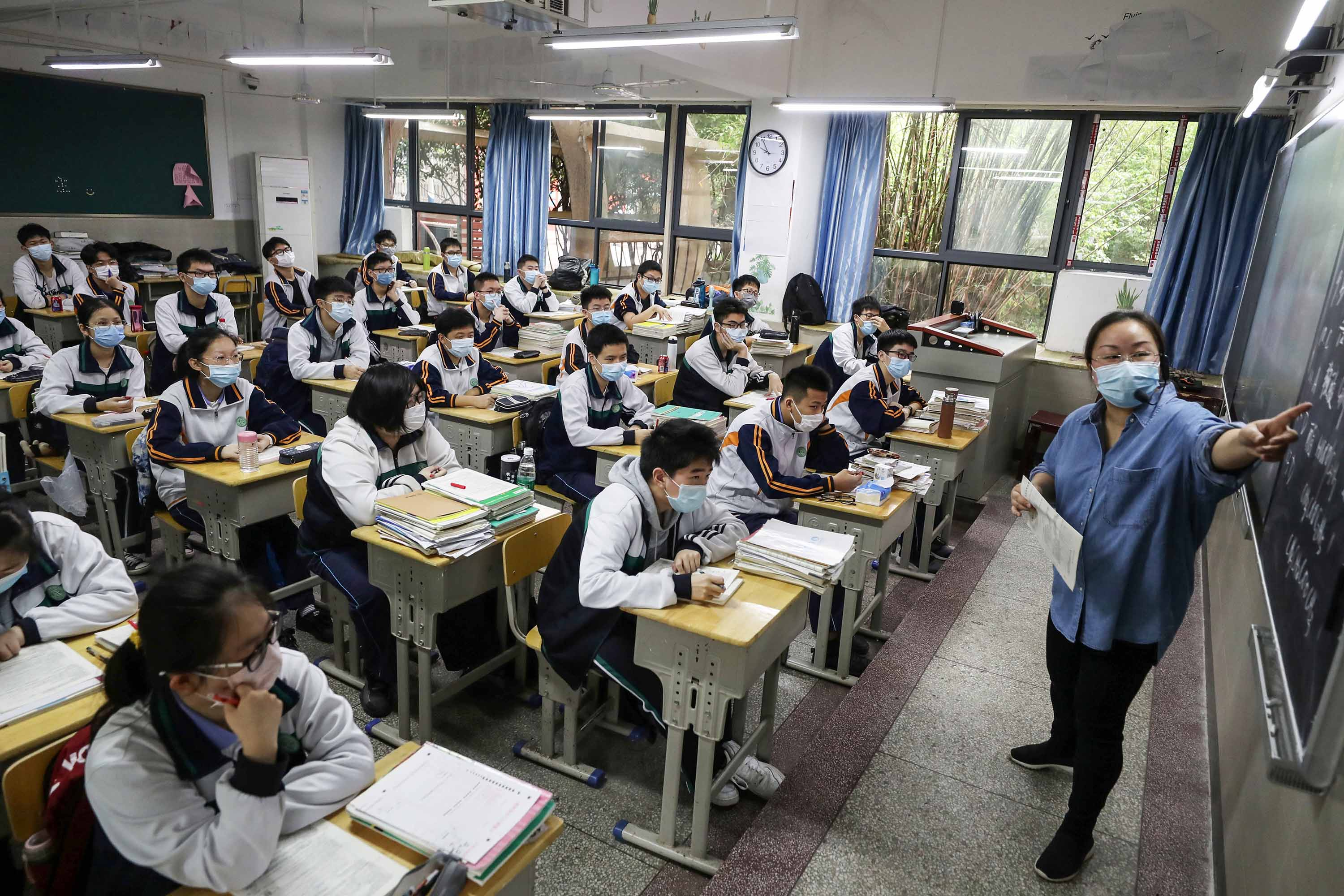 High school senior students study in a classroom in Wuhan on May 6, for the first time since their city shut down  in January.
