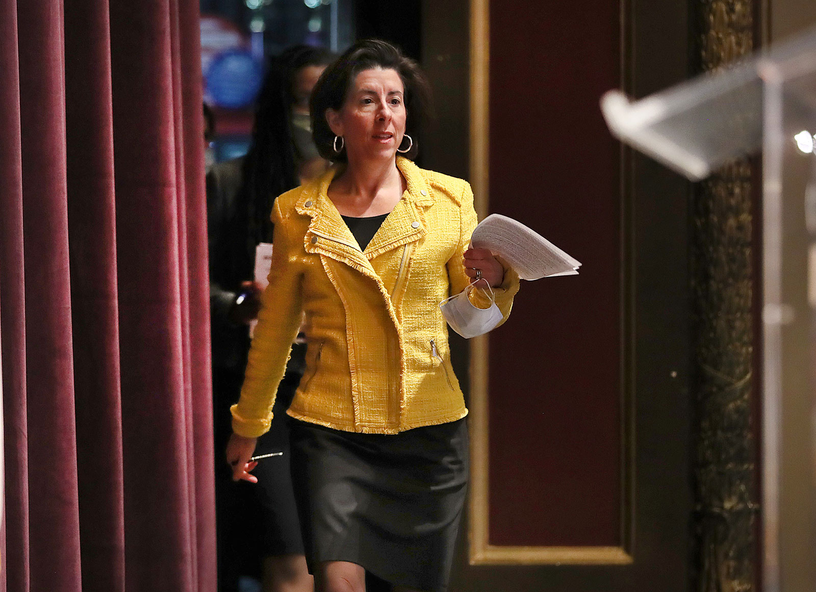Rhode Island Governor Gina M. Raimondo arrives for a news conference on May 12.