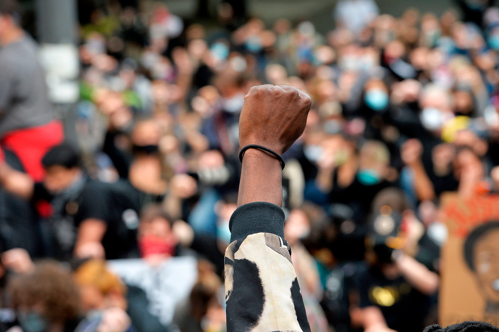 Protesters take a knee and raise their fists in a moment of silence for George Floyd and other victims of police brutality in Boston, Massachusetts on June 7.