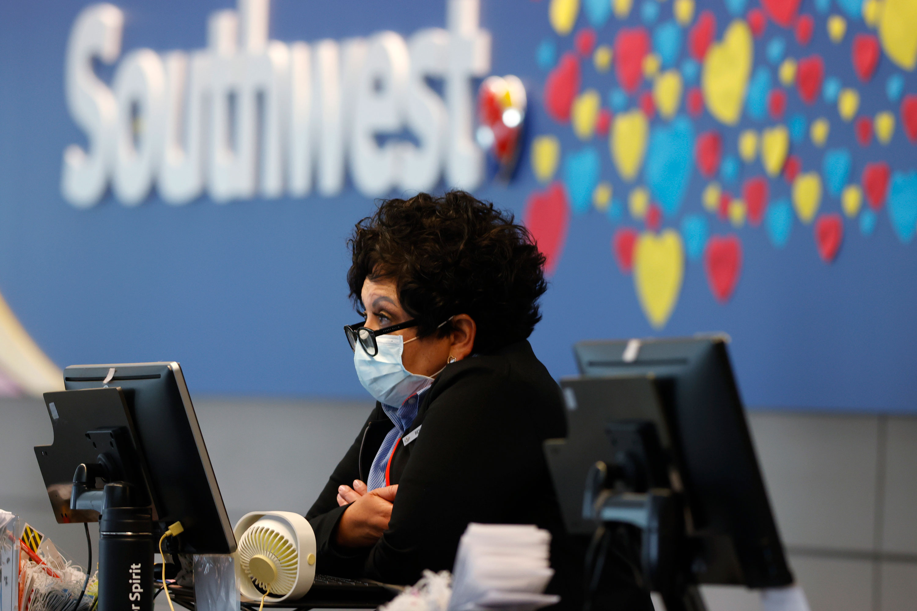 A ticketing agent waits for passengers to check in at the Southwest Airlines counter at Denver International Airport on April 23, in Denver.