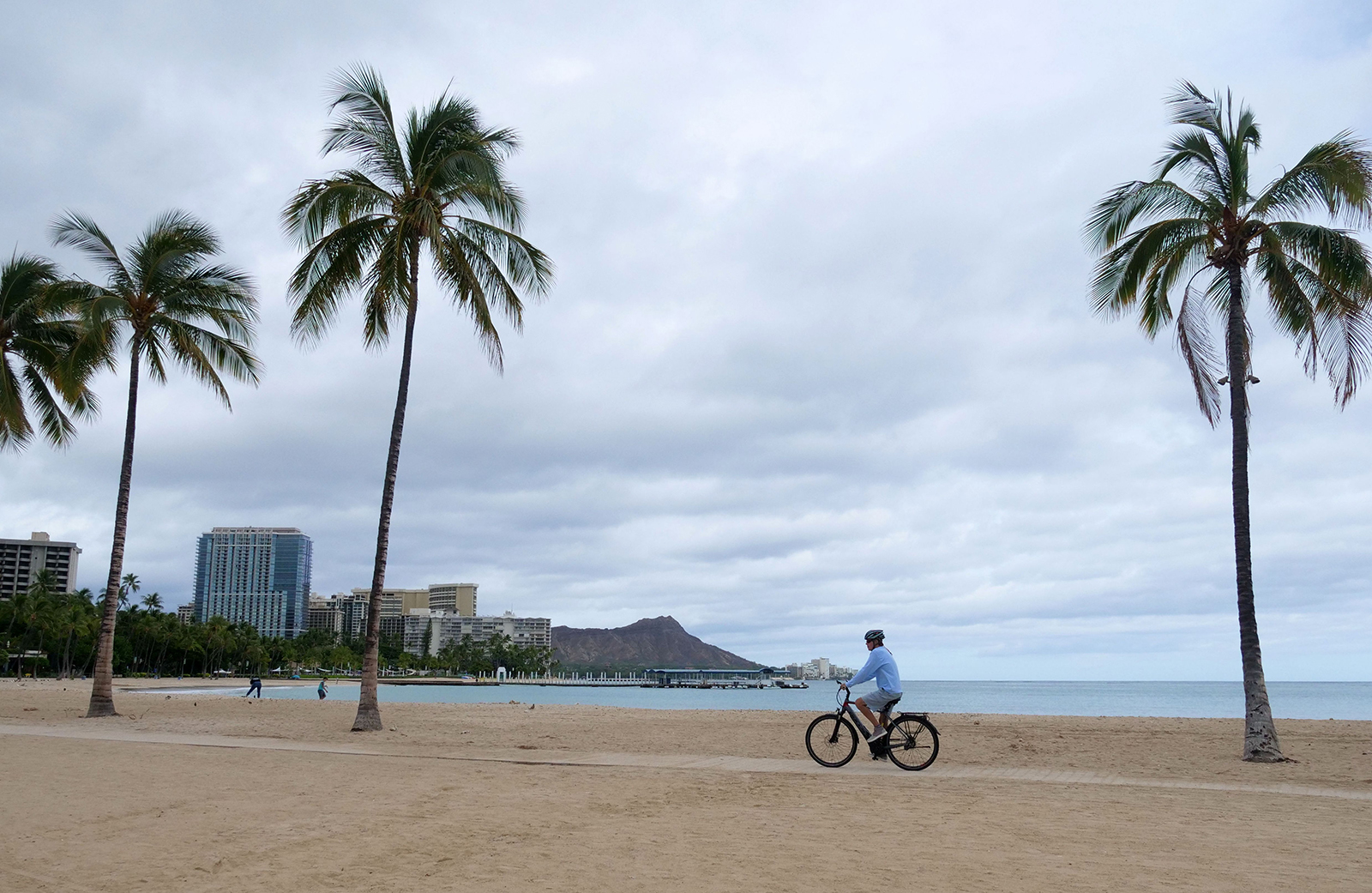 A cyclist rides along an empty Waikiki Beach in Honolulu, Hawaii, on July 26.