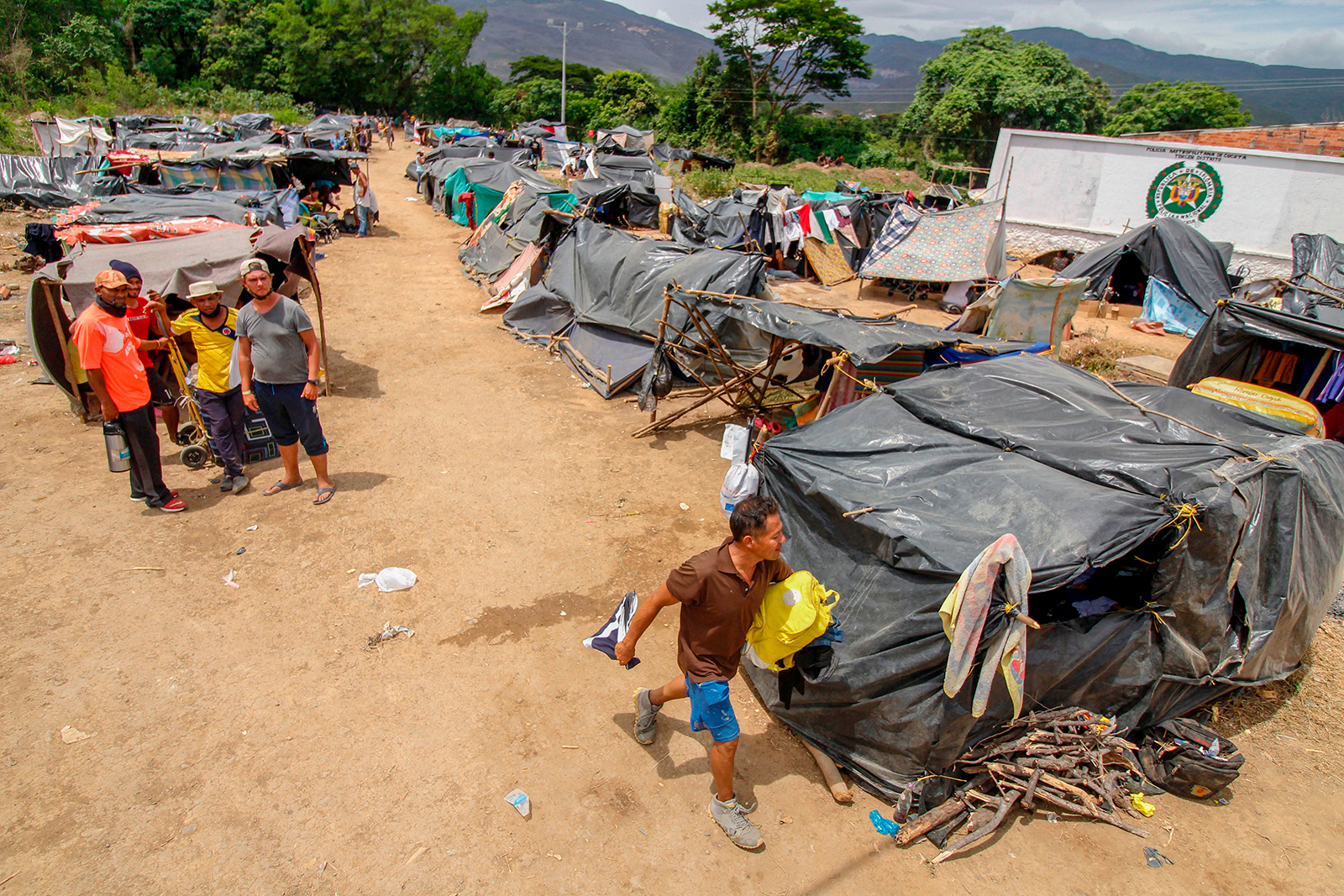 Venezuelan migrants attempting to return to their country due to the Covid-19 pandemic remain in makeshift camps at the Simon Bolivar International Bridge in Cucuta, Colombia, on July 7.