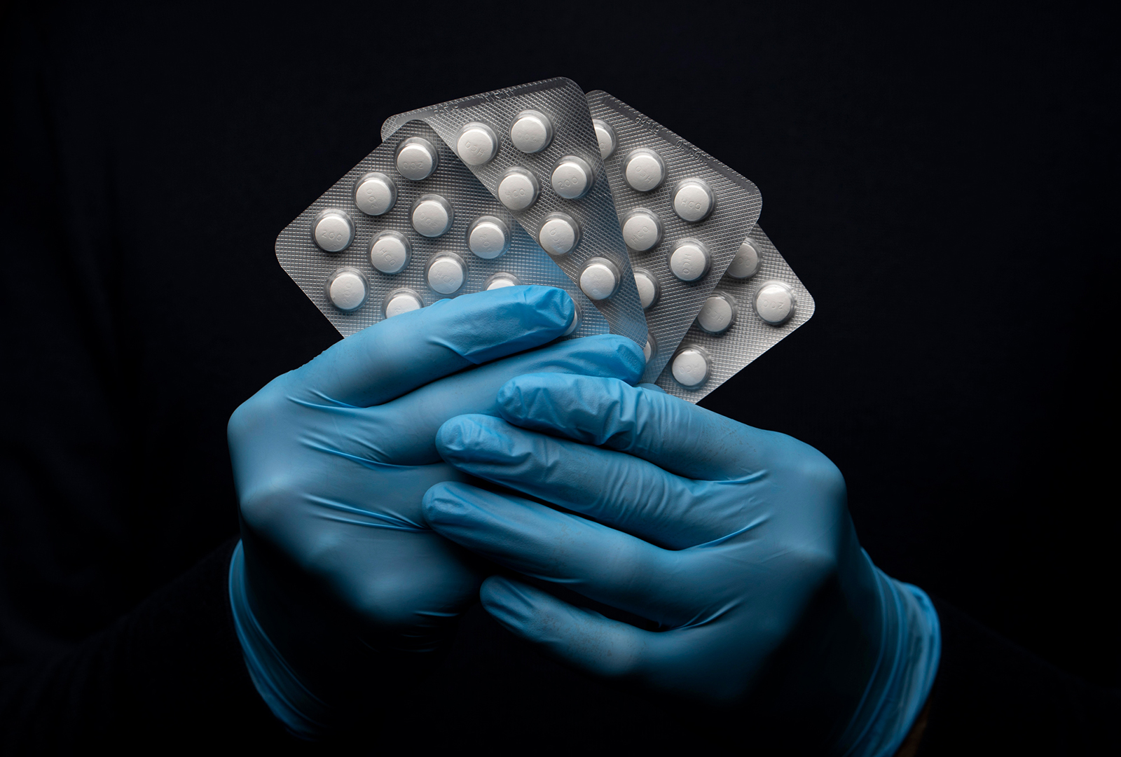 In this photo illustration a pack of Hydroxychloroquine Sulfate medication is held up on March 26 in London.