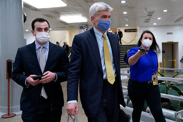 Sen. Bill Cassidy walks on Capitol Hill in Washington, Friday, February 12.