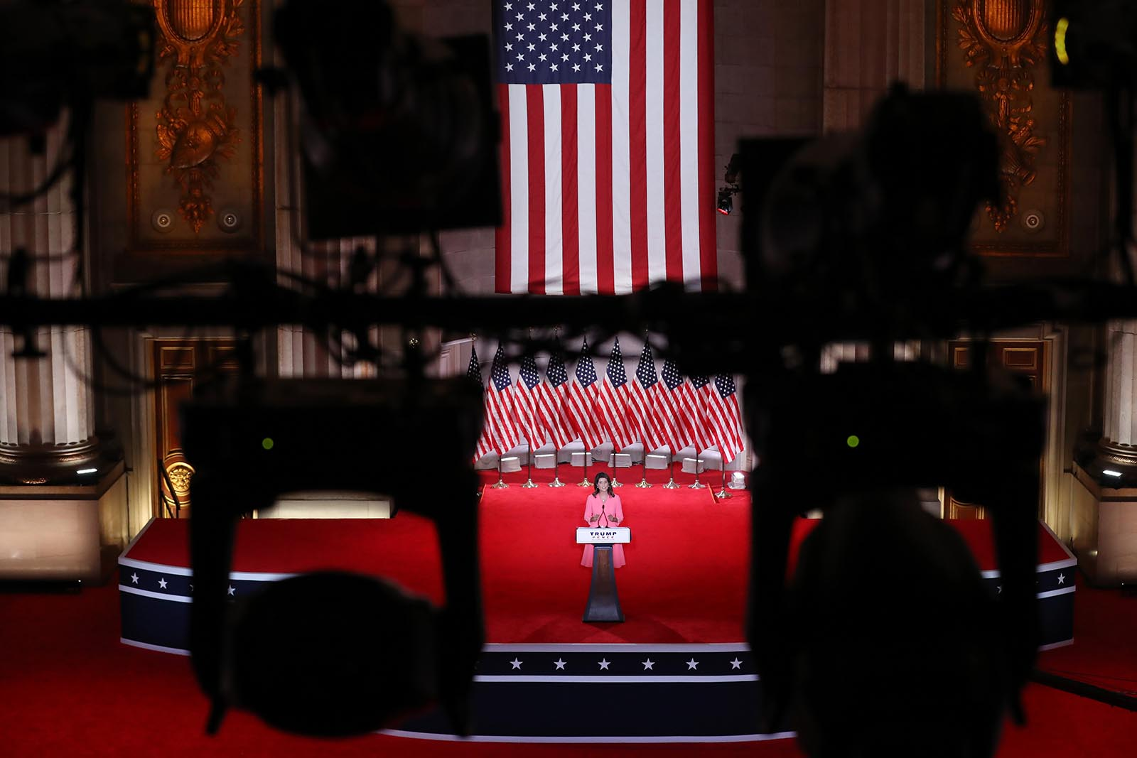 Former U.S. Ambassador to the United Nations Nikki Haley stands on stage in an empty Mellon Auditorium while addressing the Republican National Convention on Monday in Washington.