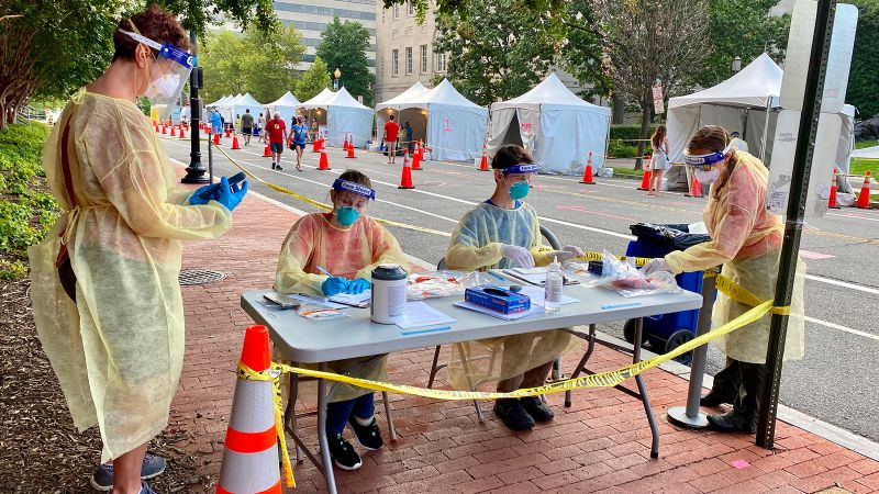Health workers provide Covid-19 testing on a street in Washington, DC, on August 14.