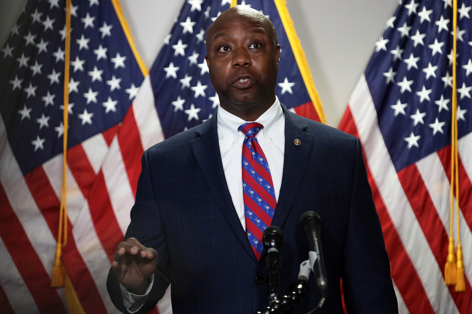 Sen. Tim Scott speaks to members of the media after the weekly Senate Republican Policy Luncheon at Hart Senate Office Building on June 23 in Washington.