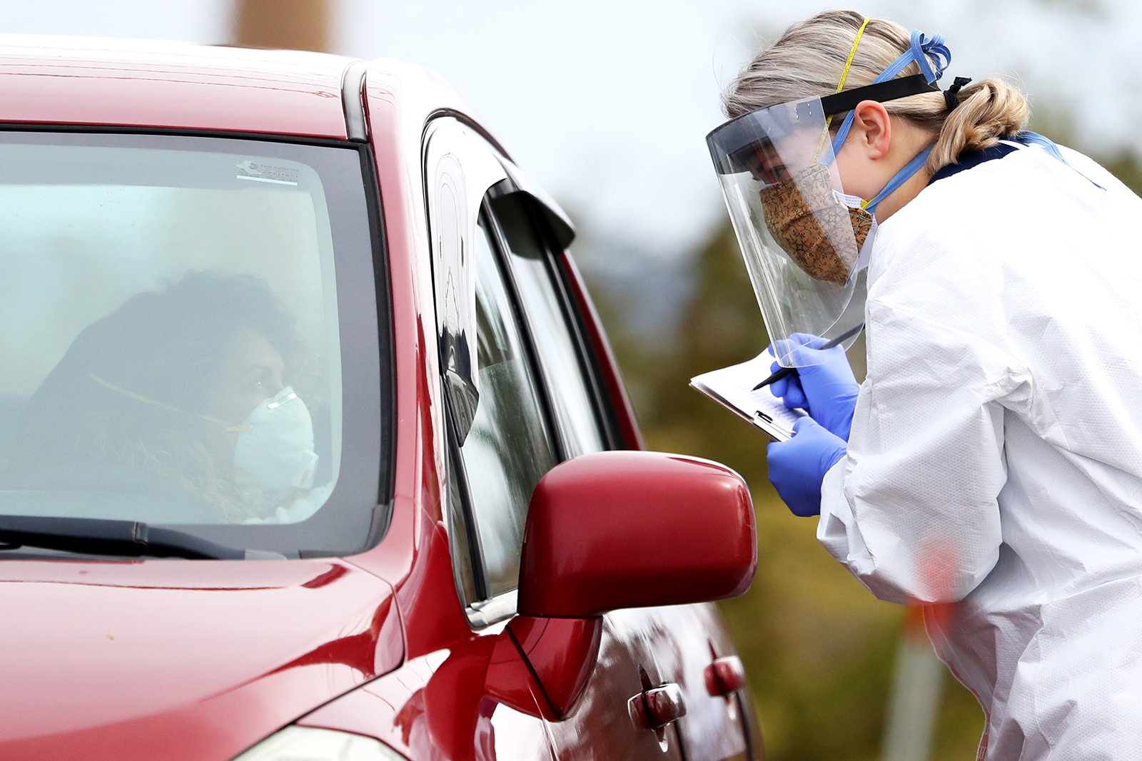 A medical professional works at a drive-thru coronavirus testing site at Cambridge Health Alliance Somerville Hospital on April 28, in Somerville, Massachusetts.