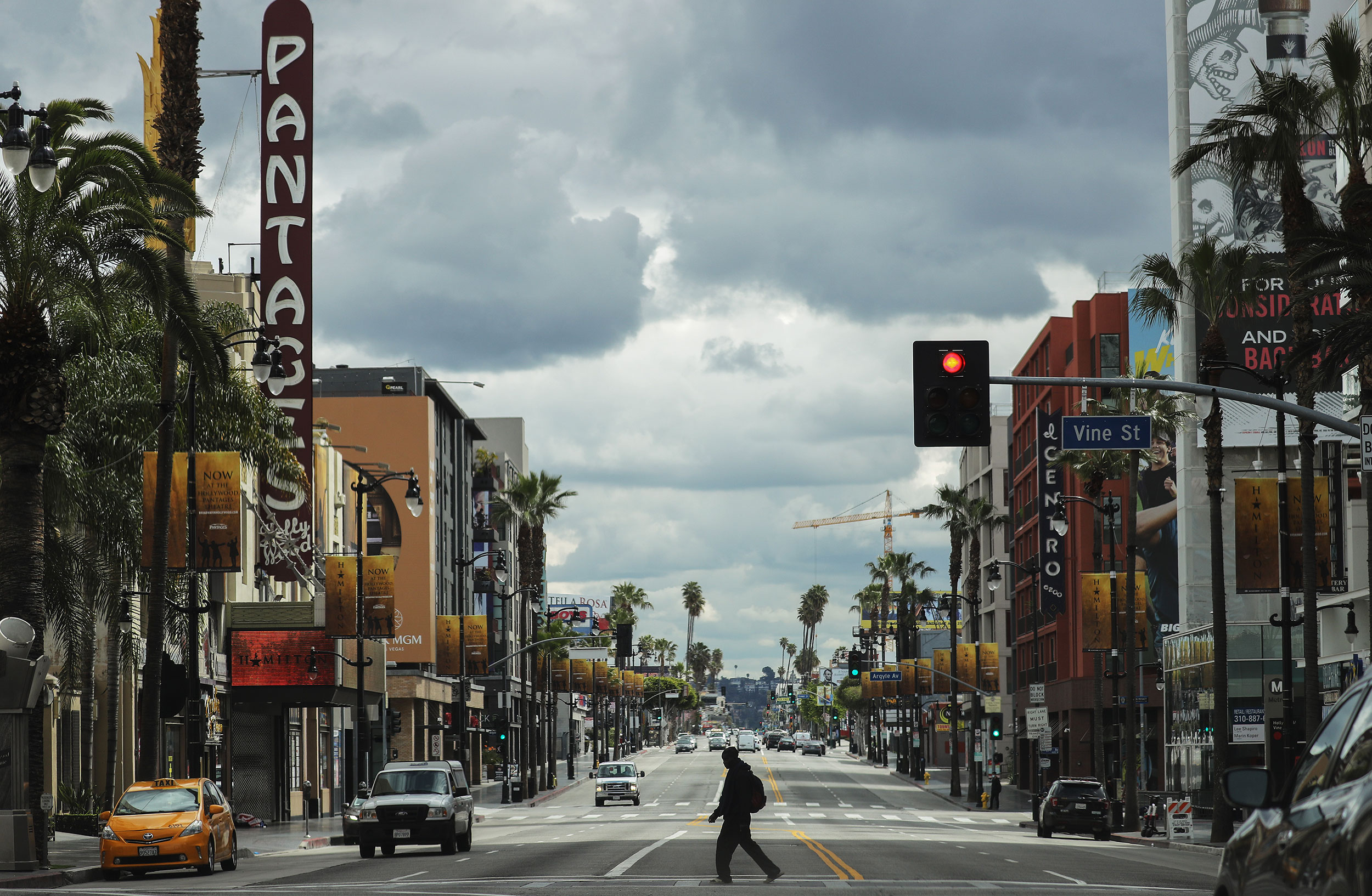 A man crosses Hollywood Boulevard in Los Angeles, California, on March 25.