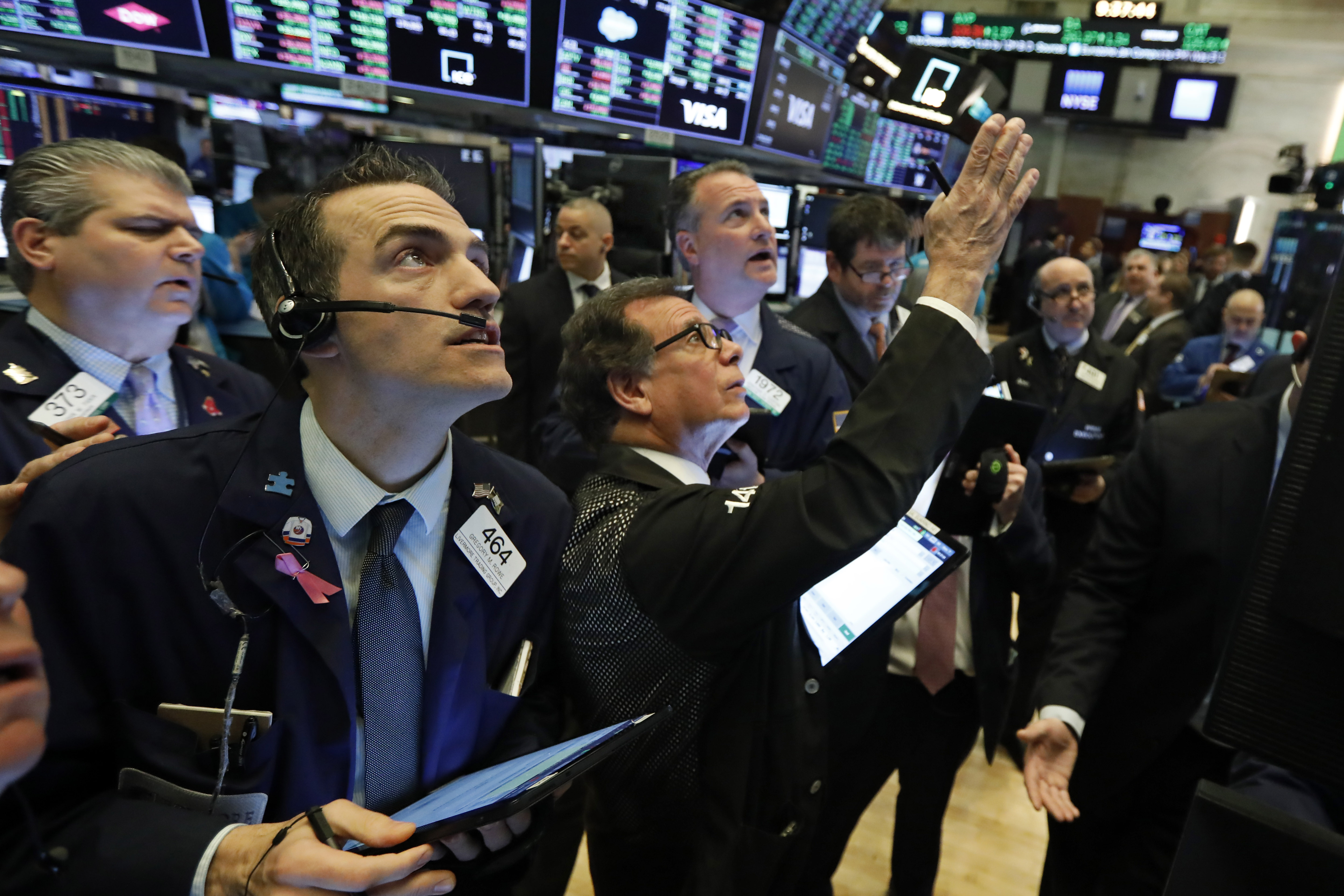 Traders gather at a post on the floor of the New York Stock Exchange, on Wednesday, March 4.
