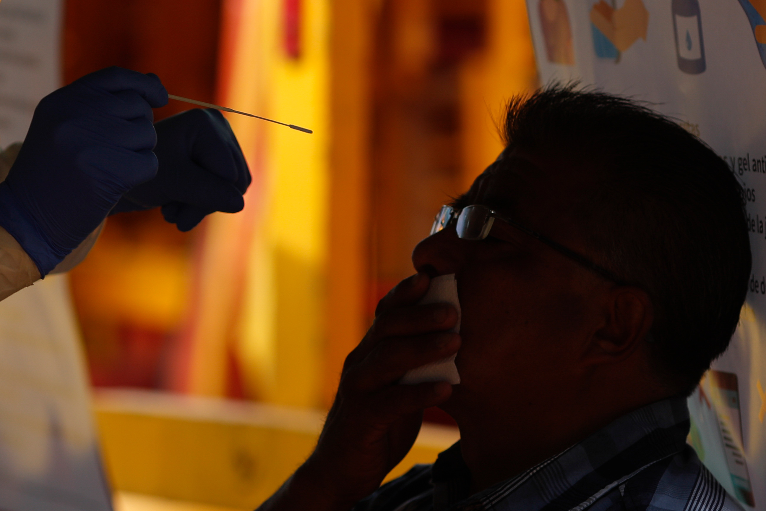 A doctor prepares to take a nasal swab for a COVID-19 test in Mexico City on September 10.