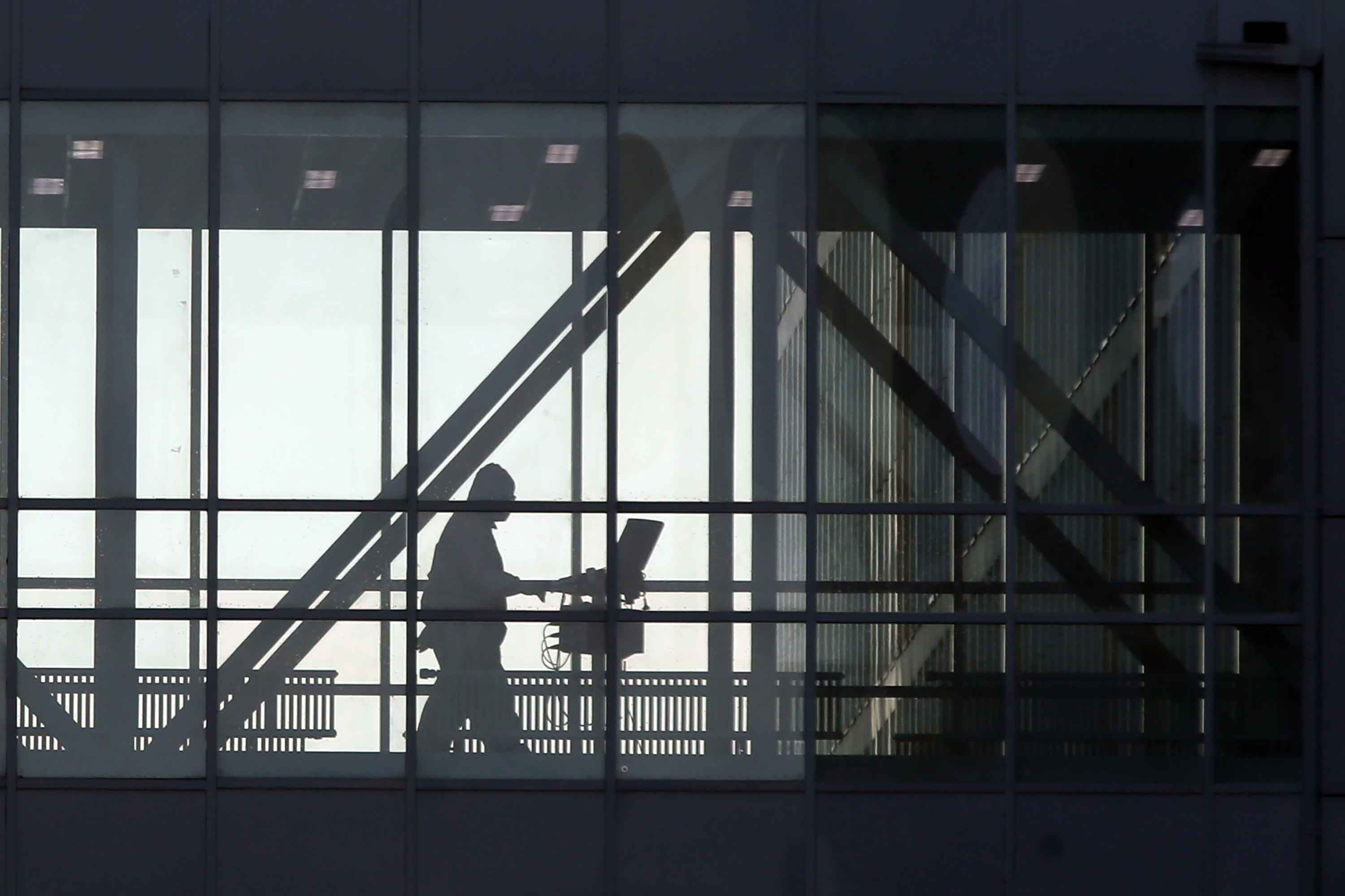 A member of medical staff is seen passing through a skywalk at the Novomoskovsky medical center for patients with suspected COVID-19 infection, in Moscow on November 6.