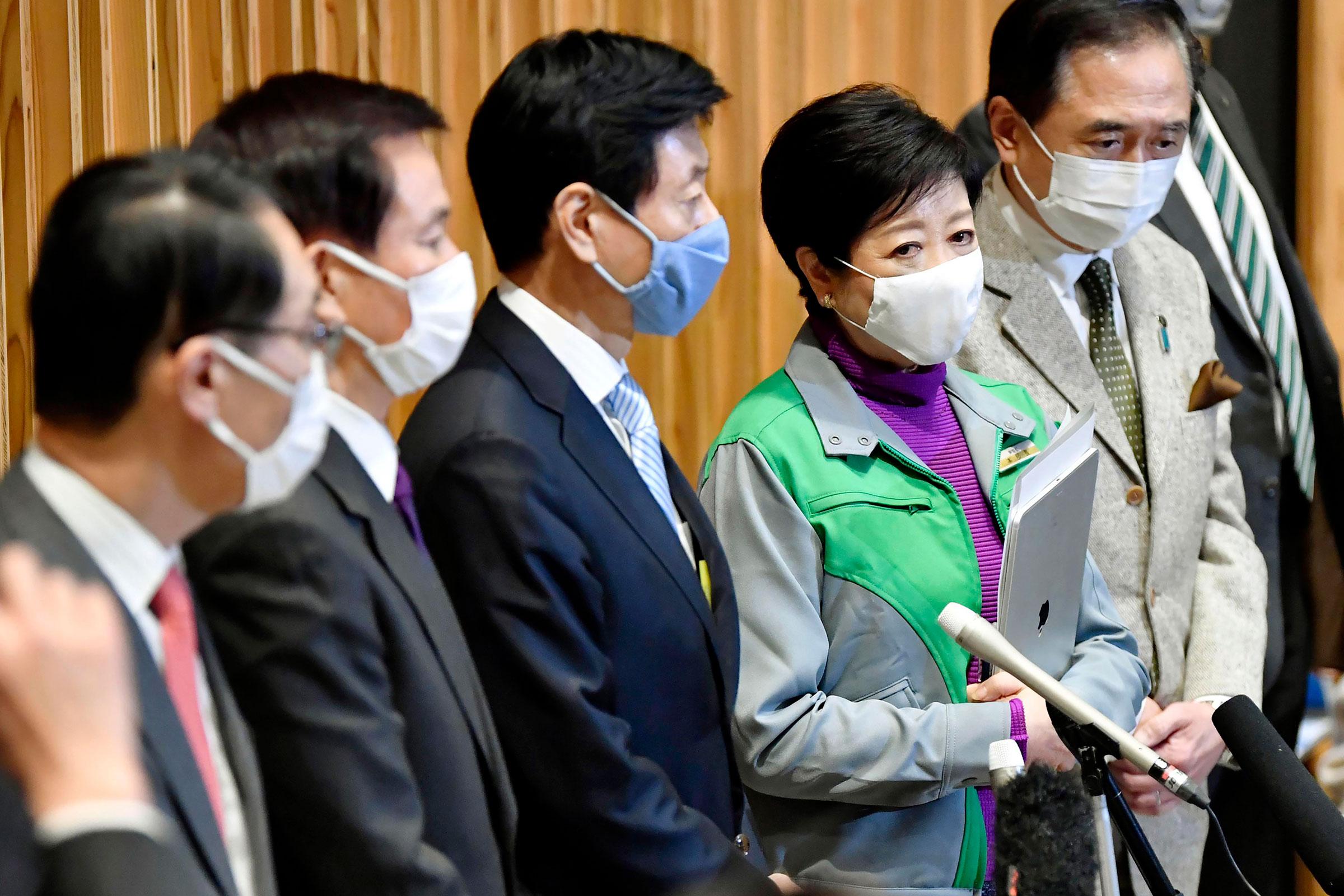 Saitama Gov. Motohiro Ono, Chiba Gov. Kensaku Morita, Japan's Economy Minister Yasutoshi Nishimura, Tokyo Gov. Yuriko Koike and Kanagawa Gov. Yuji Kuroiwa speak during a press conference on Saturday, January 2 in Tokyo.