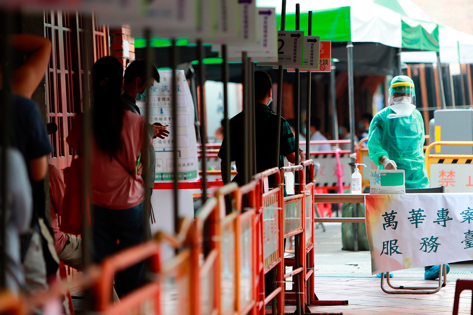 People line up at a rapid Covid-19 testing center in Wanhua district in Taipei, Taiwan, on May 19.
