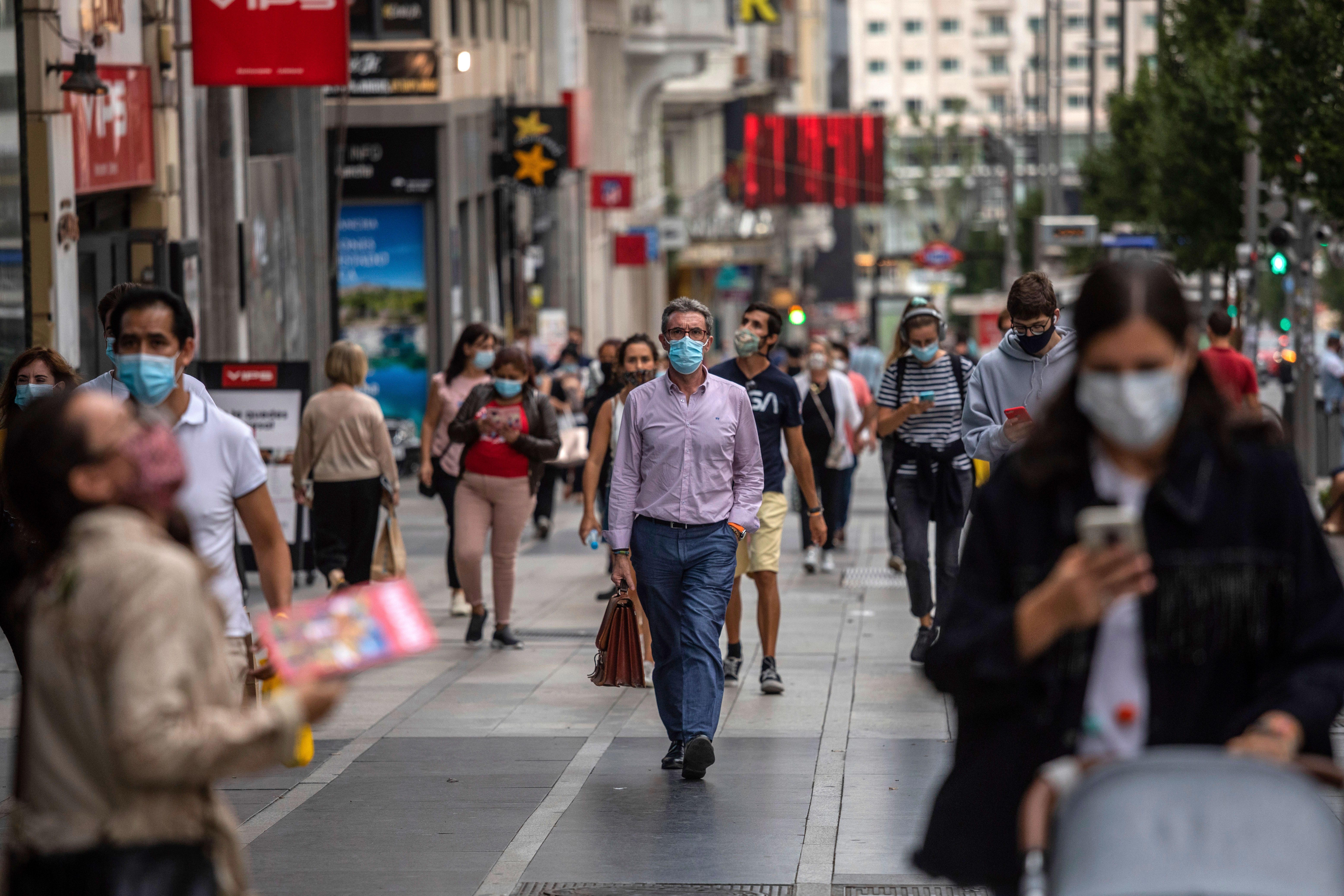 People walk in downtown Madrid on September 17.