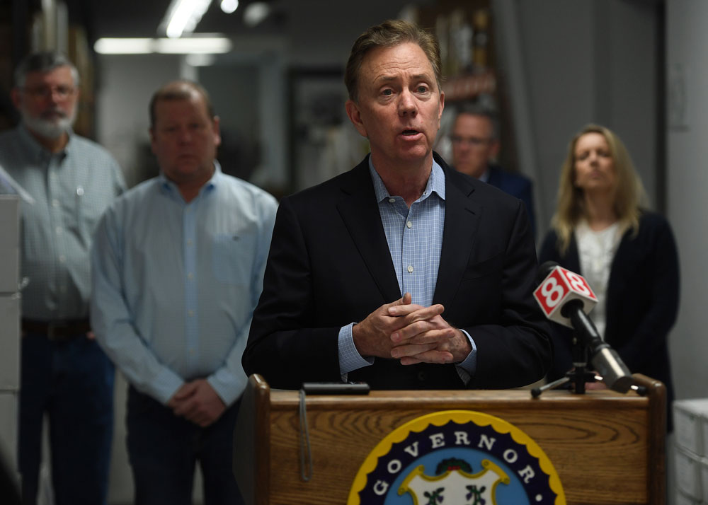 Connecticut Gov. Ned Lamont addresses the media at medical equipment manufacturer Bio-Med Devices in Guilford, Connecticut on Sunday, March 29.