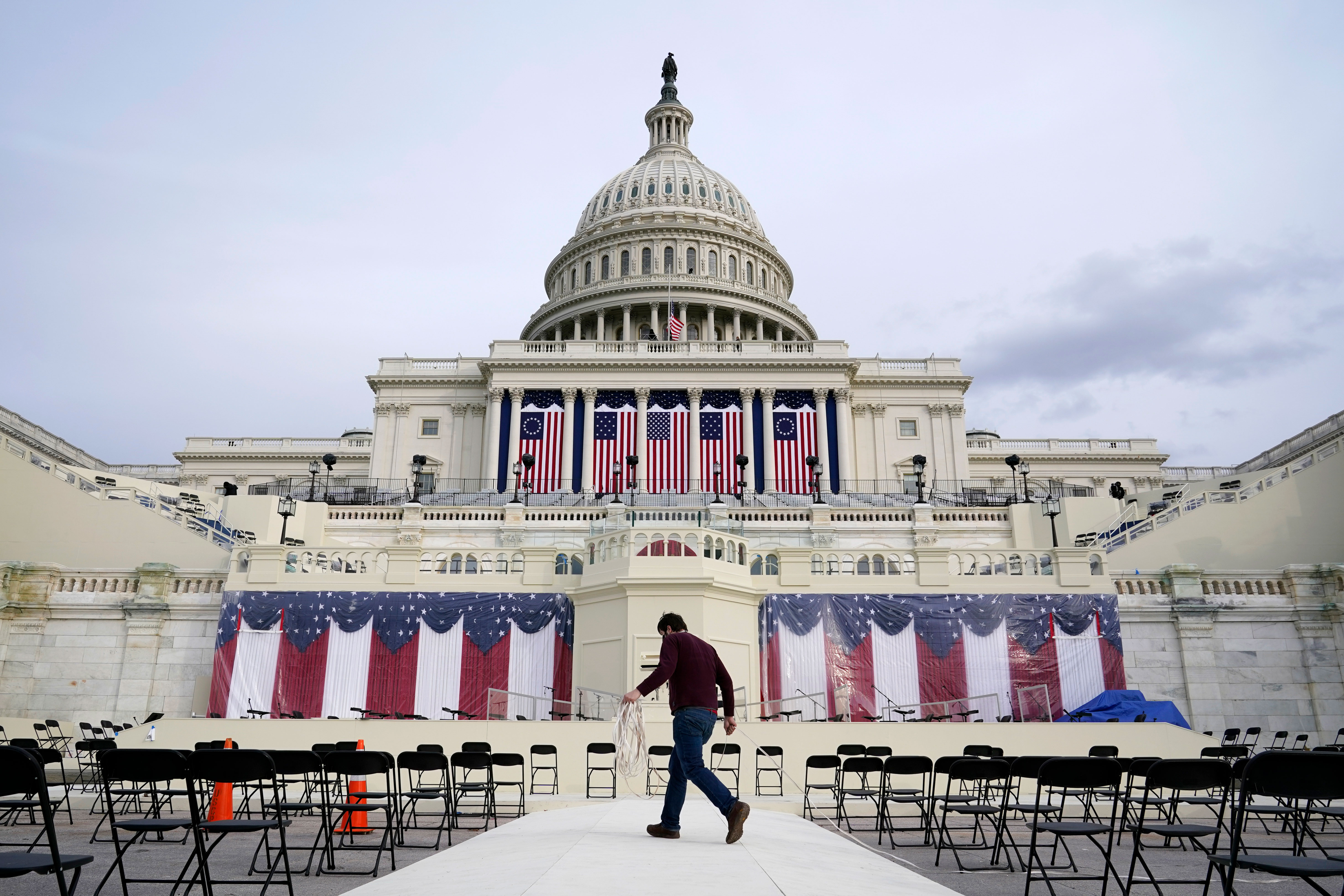 A worker pulls cables as preparations take place on January 16 at the Capitol for President-elect Joe Biden's inauguration ceremony.