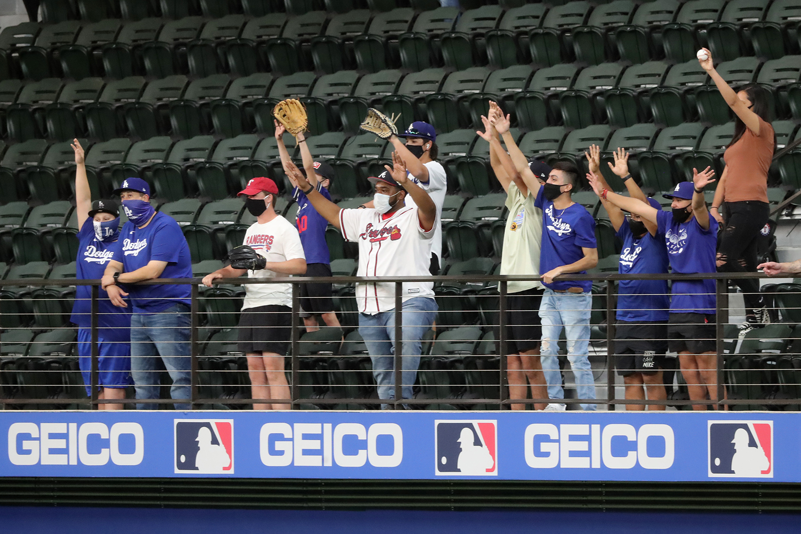 Atlanta Braves fans and Los Angeles Dodgers fans cheer during batting practice before Game 1 for the best-of-seven National League Championship Series at Globe Life Field in Arlington, Texas, on October 12.
