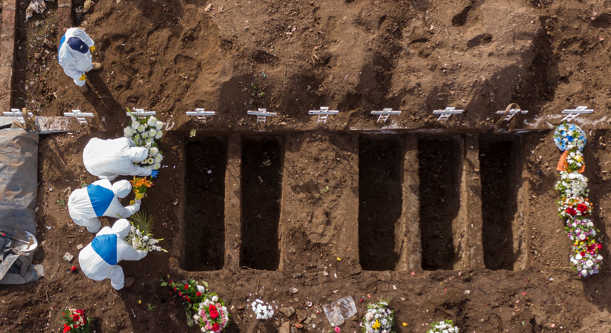 Aerial view showing the burial of a victim of COVID-19 at the General Cemetery in Santiago, Chile on June 23, 2020