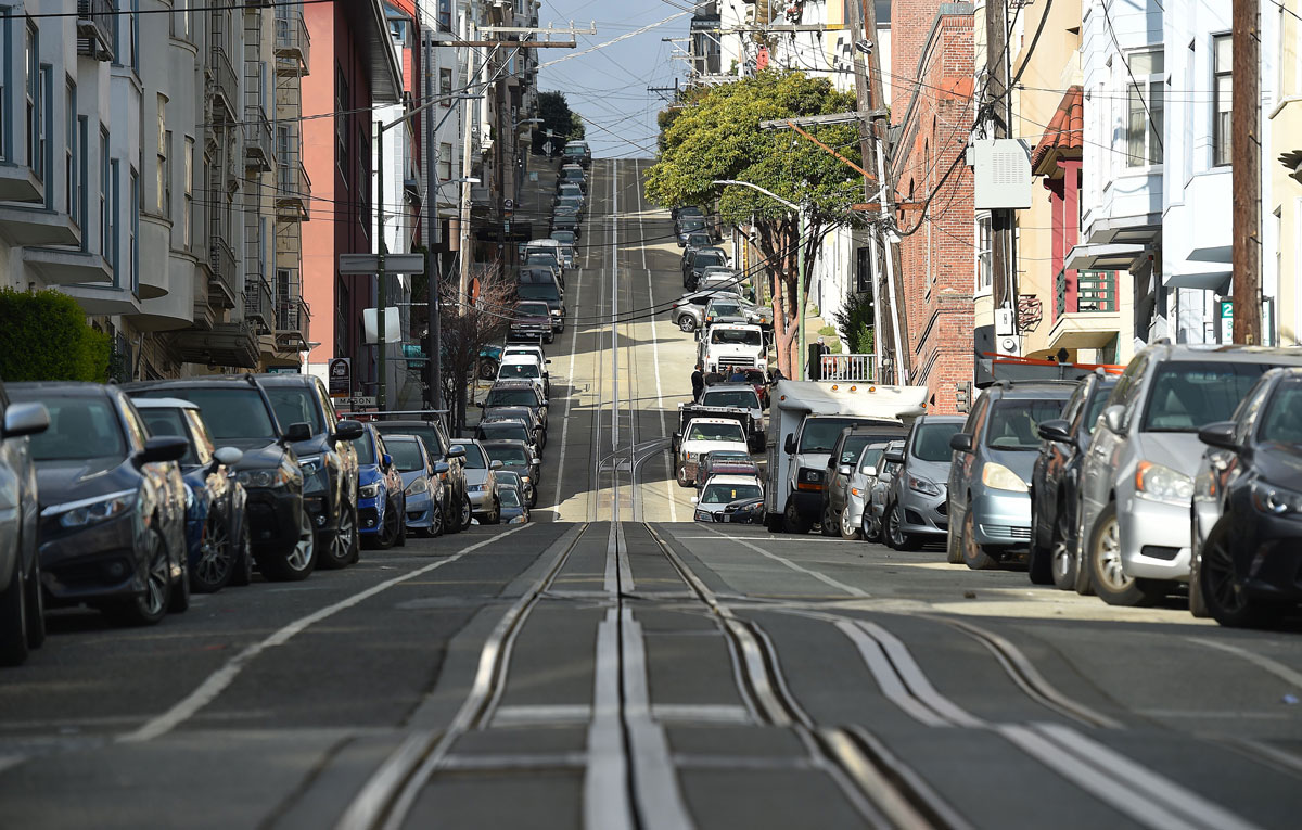 Washington Street is seen mostly empty in San Francisco, California on March 17, the first day of a Stay Home order to slow the spread of the coronavirus.