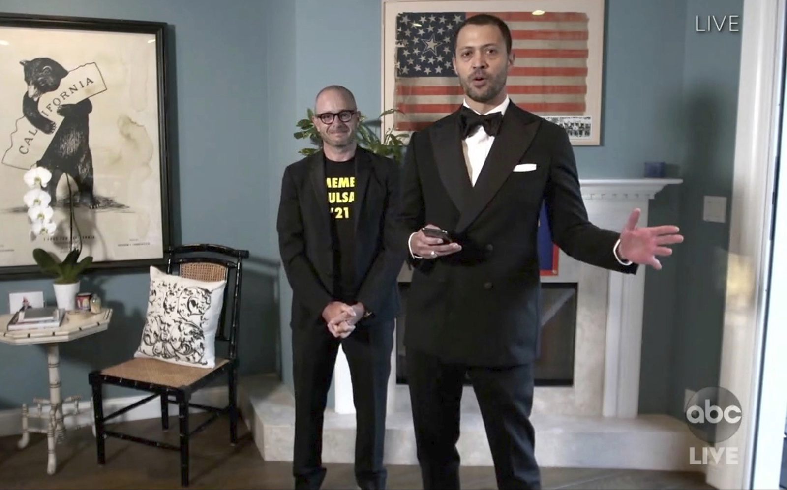 "In this video grab captured on Sept. 20, 2020, courtesy of the Academy of Television Arts & Sciences and ABC Entertainment, Damon Lindelof, left, and Cord Jefferson accept the award for outstanding writing for a limited series, movie or dramatic special for ""Watchmen"" for ""This Extraordinary Being"" during the 72nd Emmy Awards broadcast."