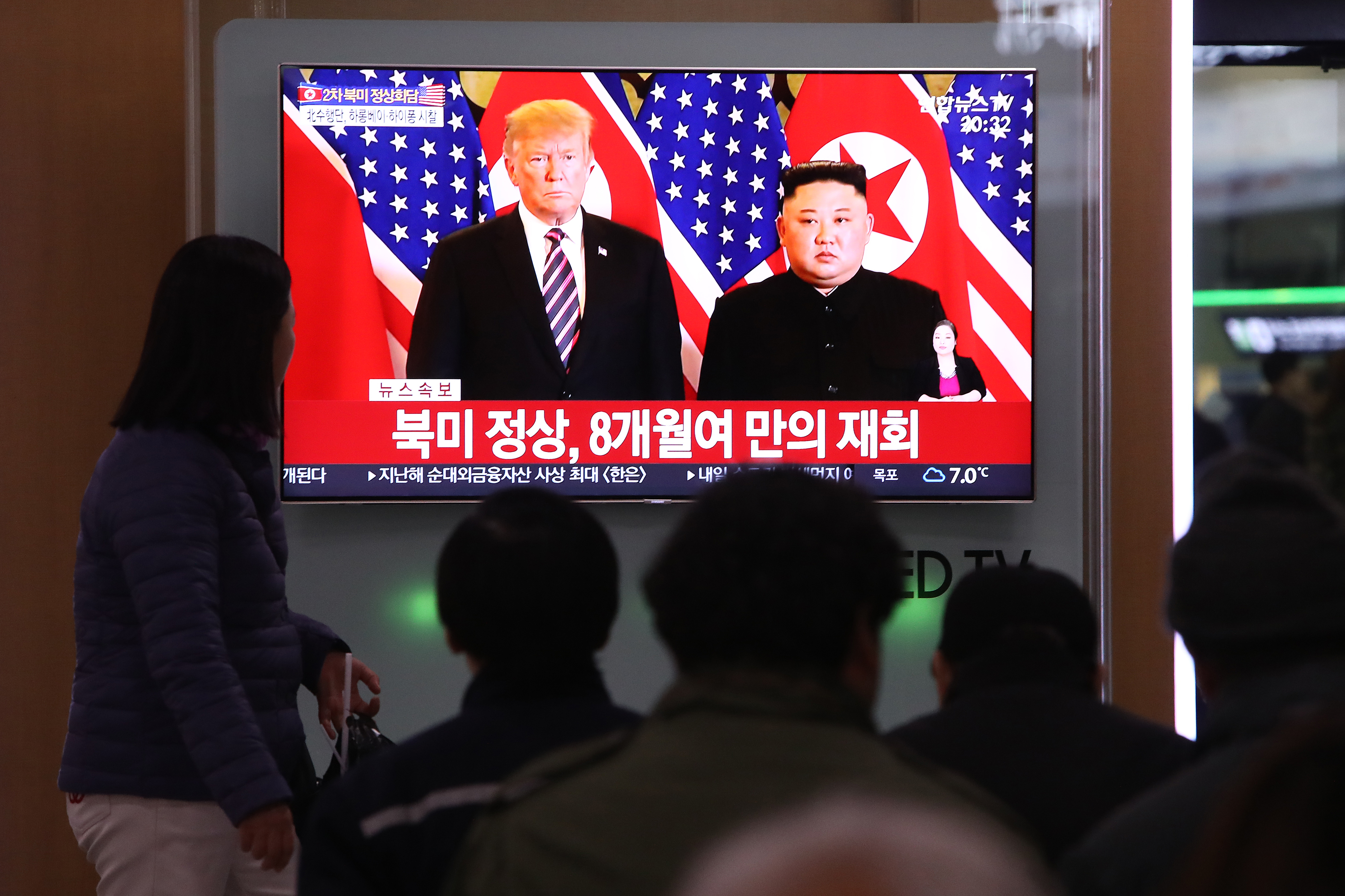 South Korean watch a screen reporting the Trump and Kim summit.
