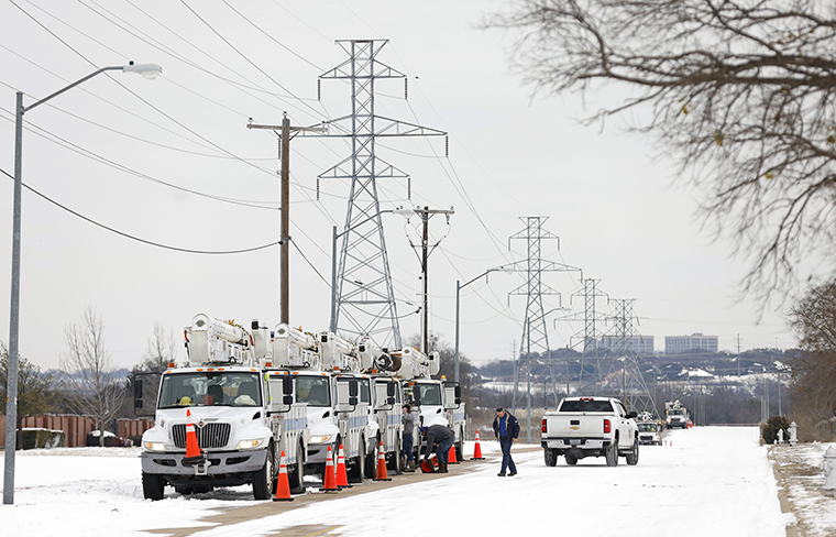 Pike Electric service trucks line up after a snow storm on February 16, in Fort Worth, Texas.