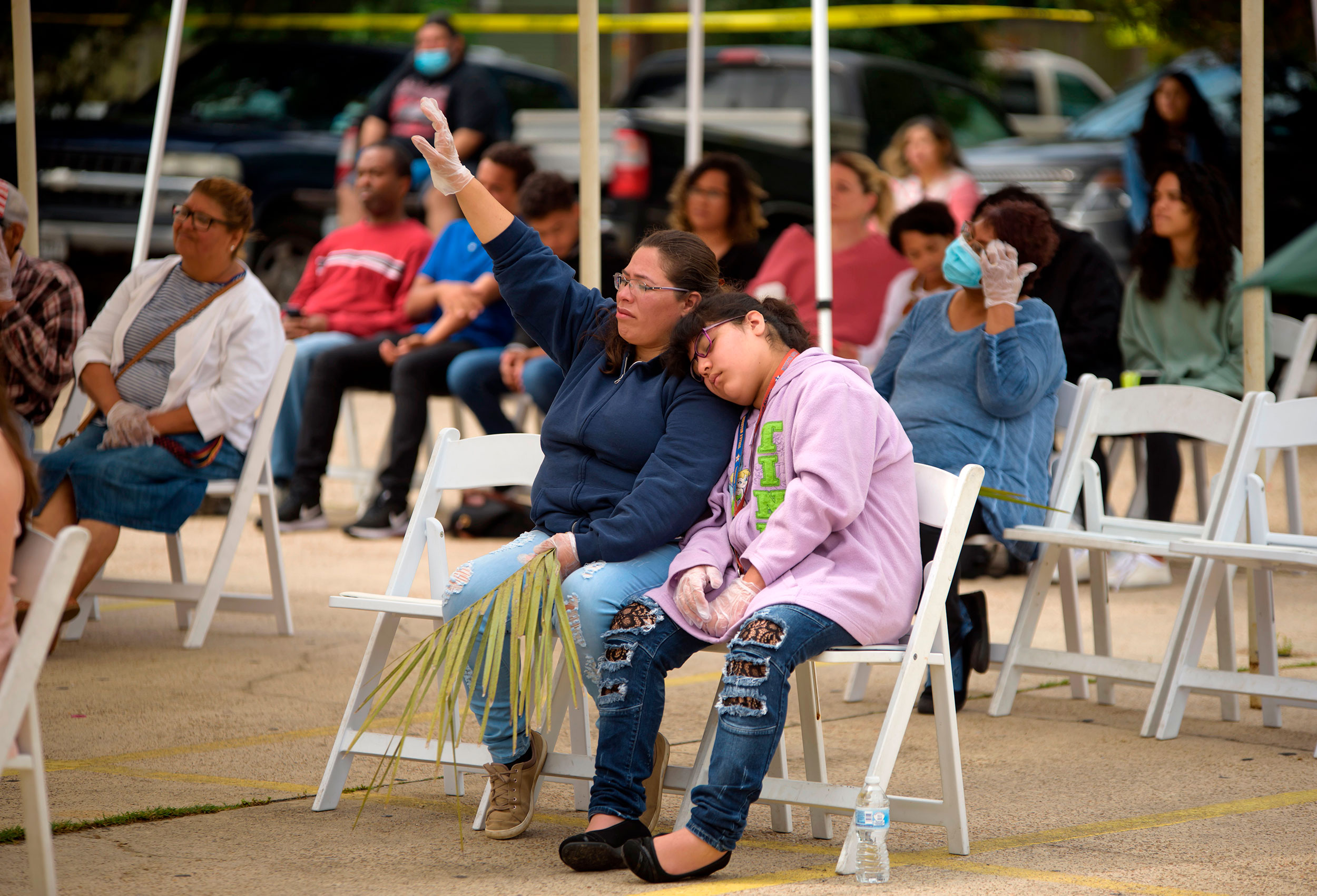 Parishioners attend a Sunday morning worship service at City On A Hill Church in Houston, Texas. The service was held outside in the church's parking lot and the church practiced social distancing during the service.