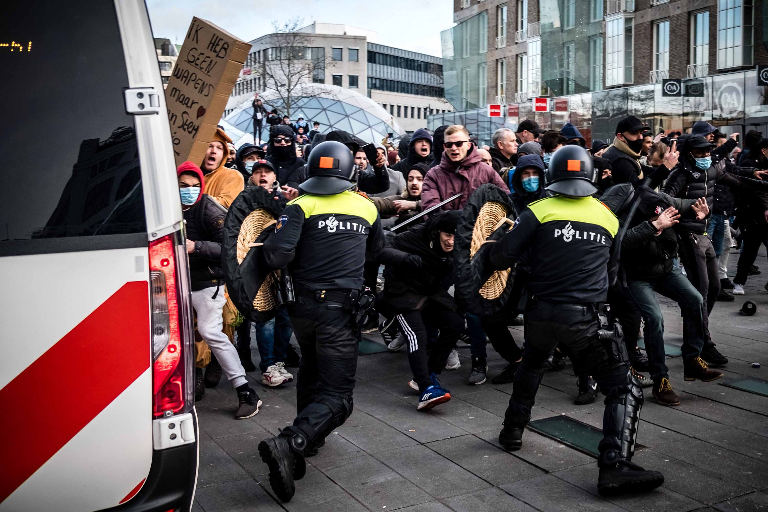 Protesters clash with anti-riot police officers during a demonstration against coronavirus restrictions in Eindhoven on January 24.