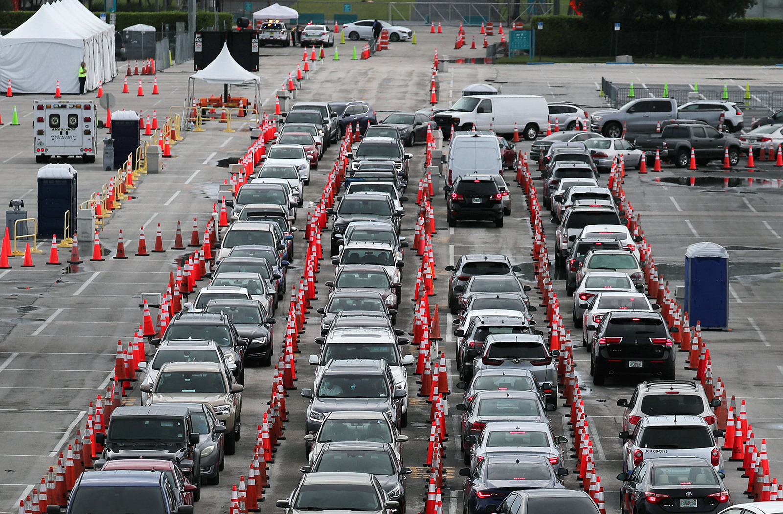 Cars are seen as the drivers wait to be tested for Covid-19 at the test site located in the Hard Rock Stadium parking lot on July 6, in Miami Gardens, Florida.