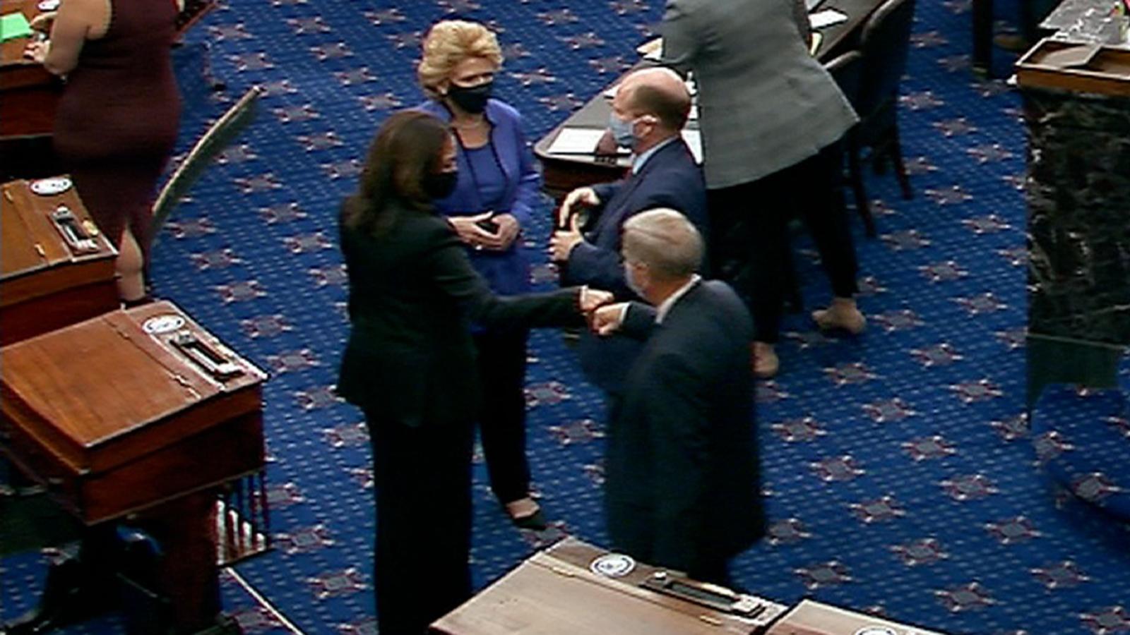 Sen. Lindsey Graham gives Vice President-elect, and current US senator, KamalaHarriss a fist bump.