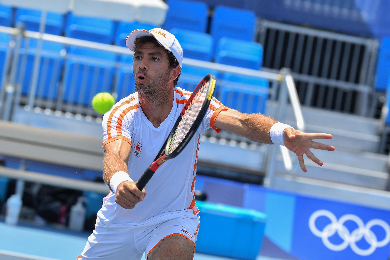 Netherlands' Jean-Julien Rojer returns a shot during a doubles first round tennis match on July 24.