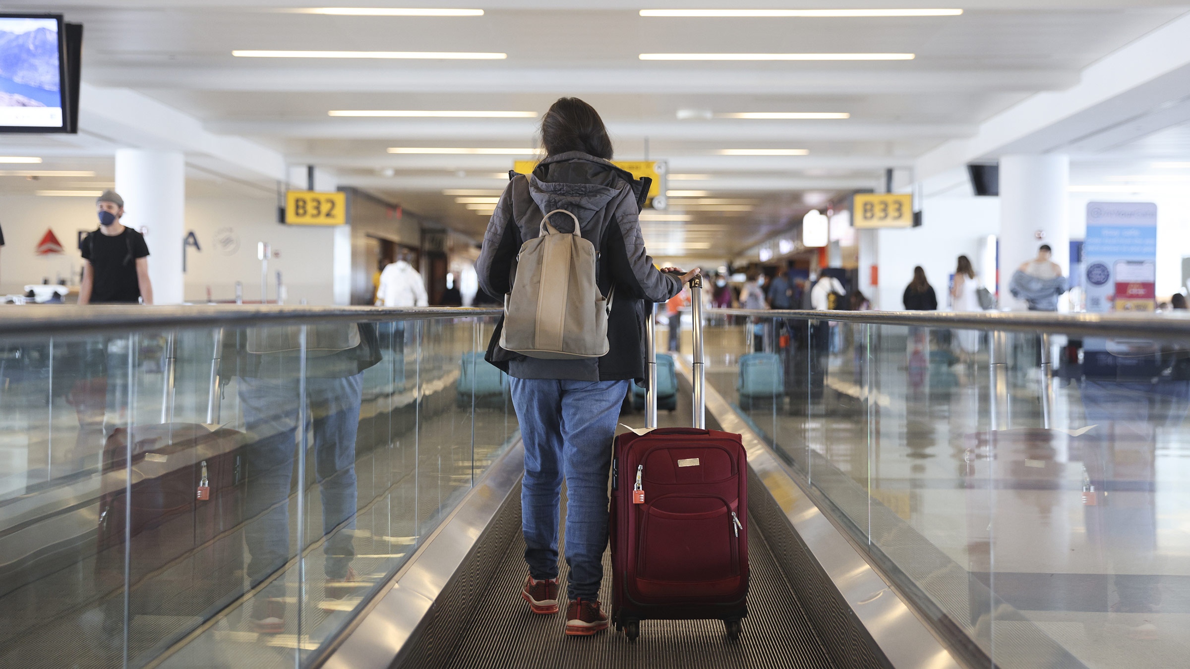 A traveler walks through John F. Kennedy International Airport in New York, on March 26.