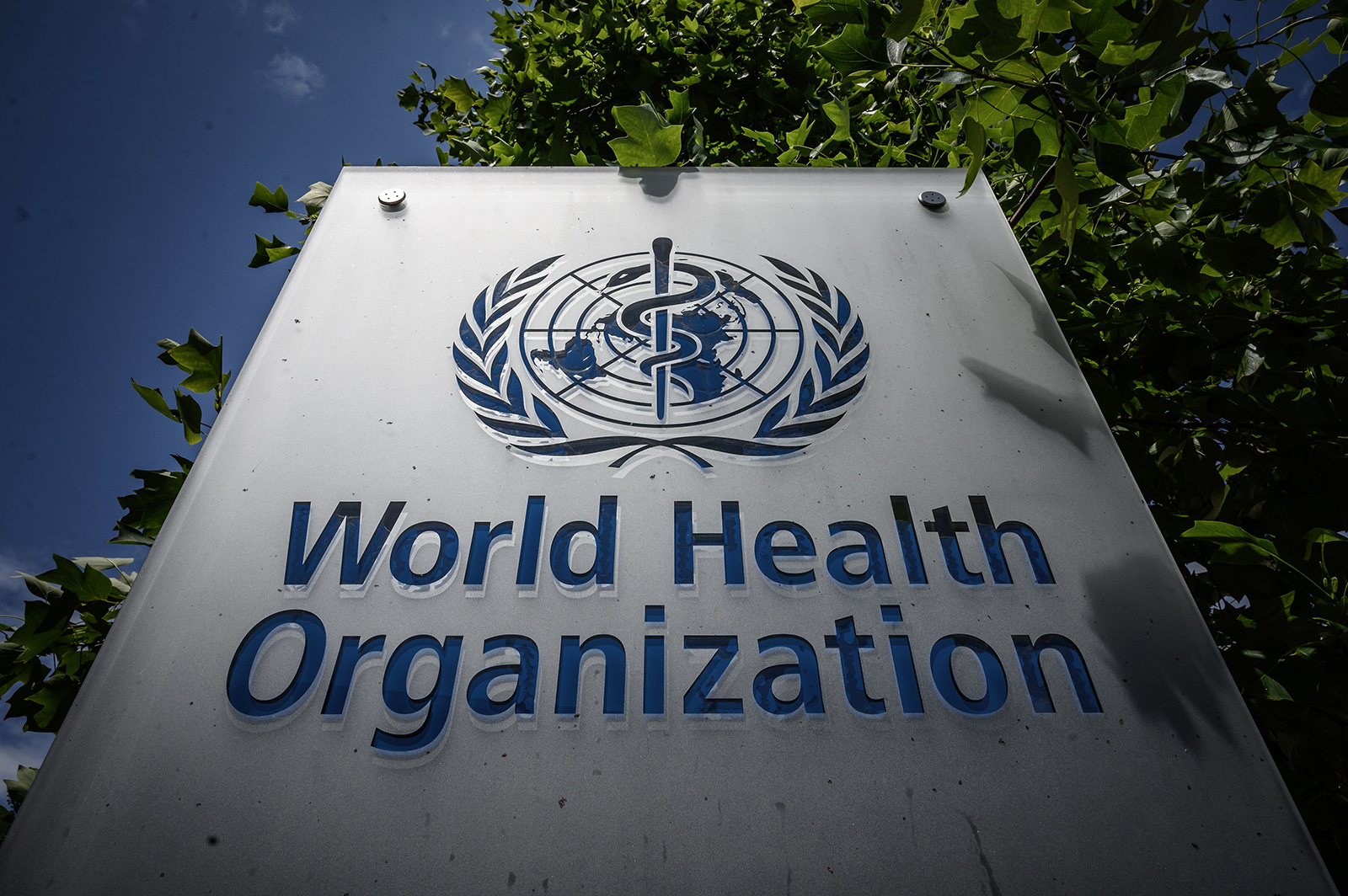 The World Health Organization (WHO) sign stands at their headquarters in Geneva, Switzerland.