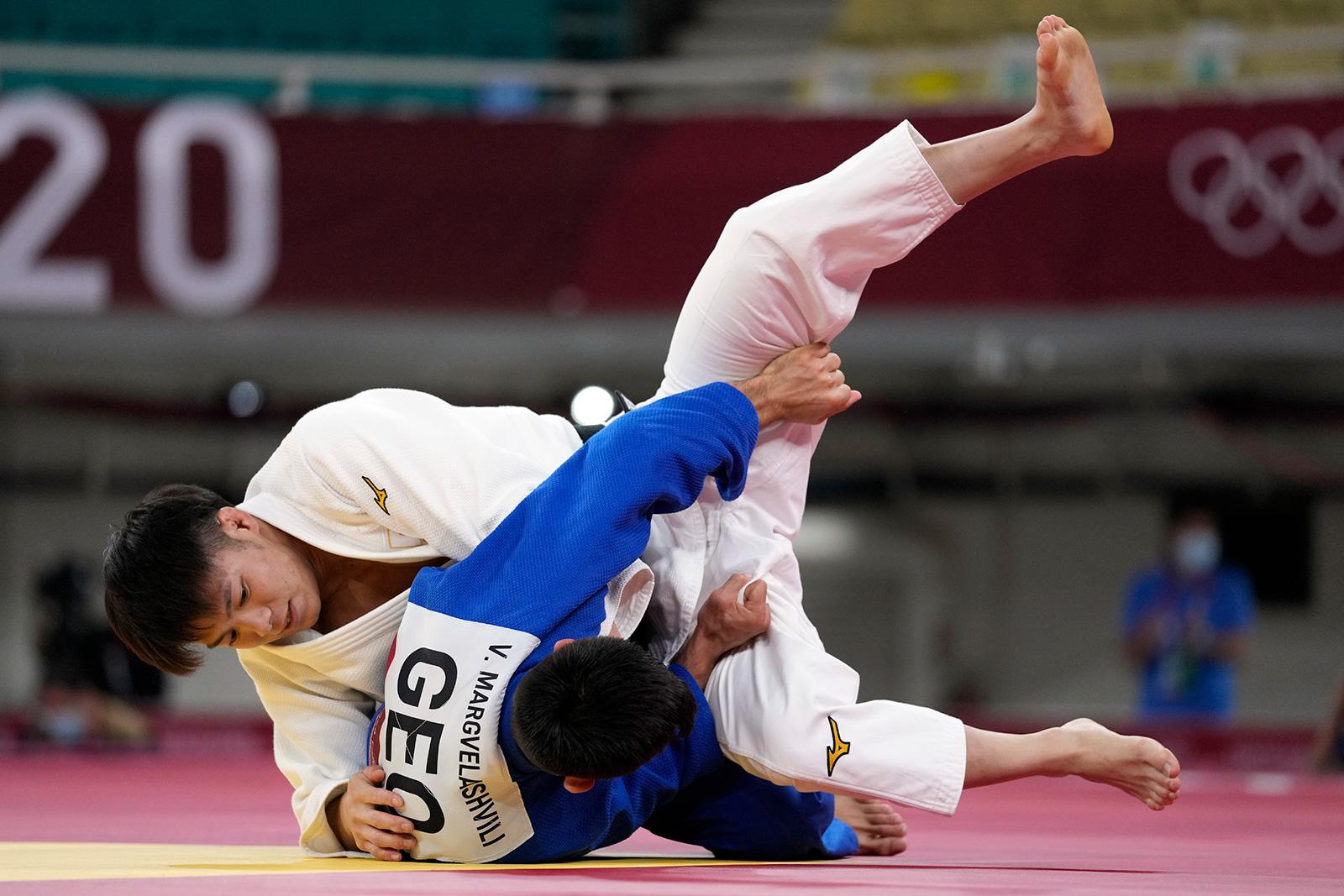 Hifumi Abe of Japan, top, and Vazha Margvelashvili of Georgia compete during their judo match on Sunday, July 25.