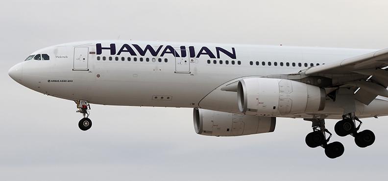 A Hawaiian Airlnes Airbus A330 (A330-200) jetliner lands at McCarran International Airport in Las Vegas, Nevada, on Tuesday, February 26, 2019.