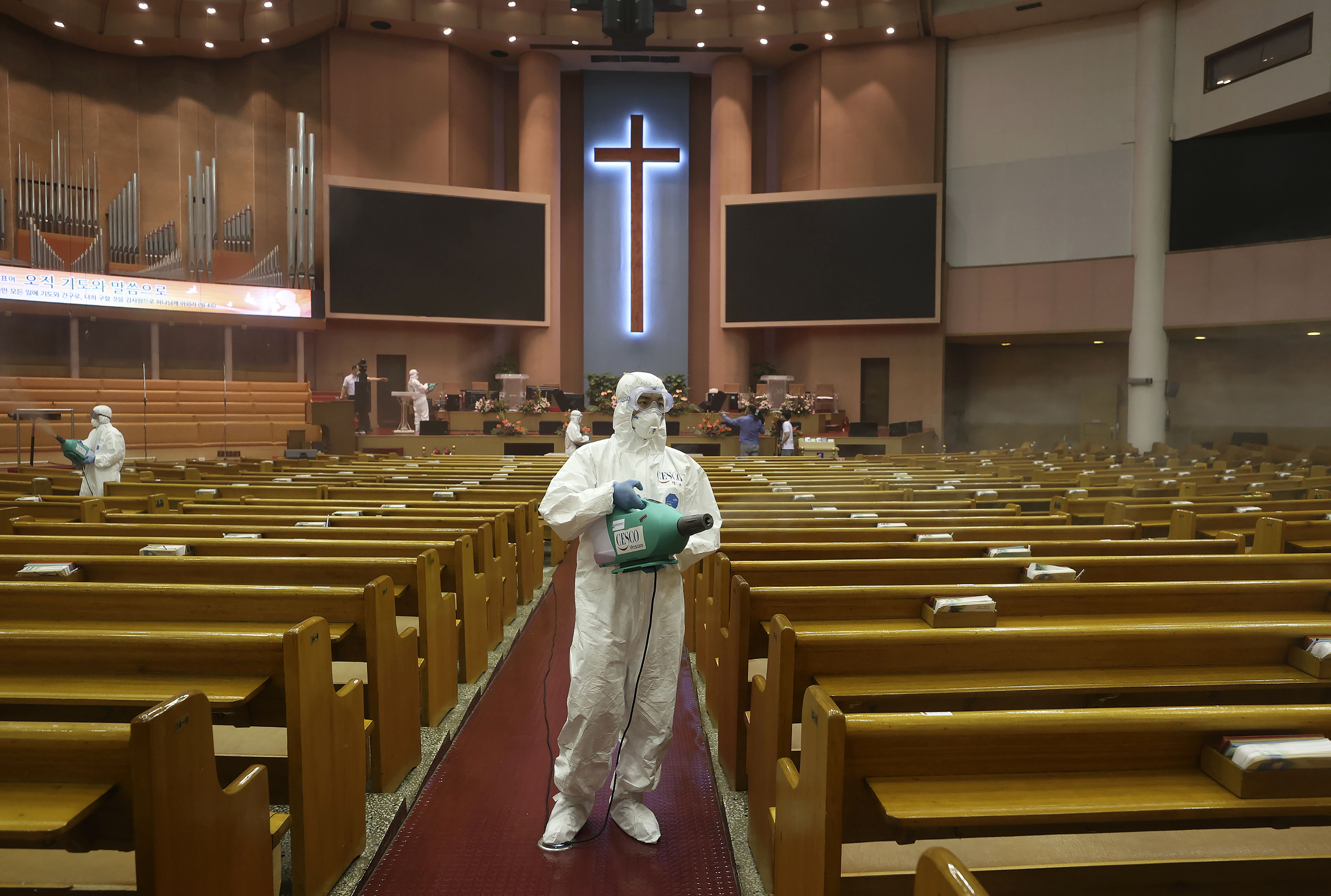 Public officials disinfect a church in Seoul, South Korea, on August 18.