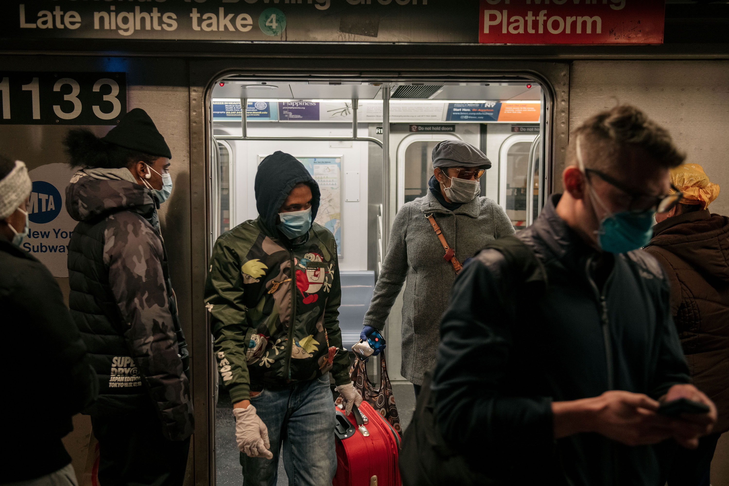 Commuters exit a subway train in New York on April 17.