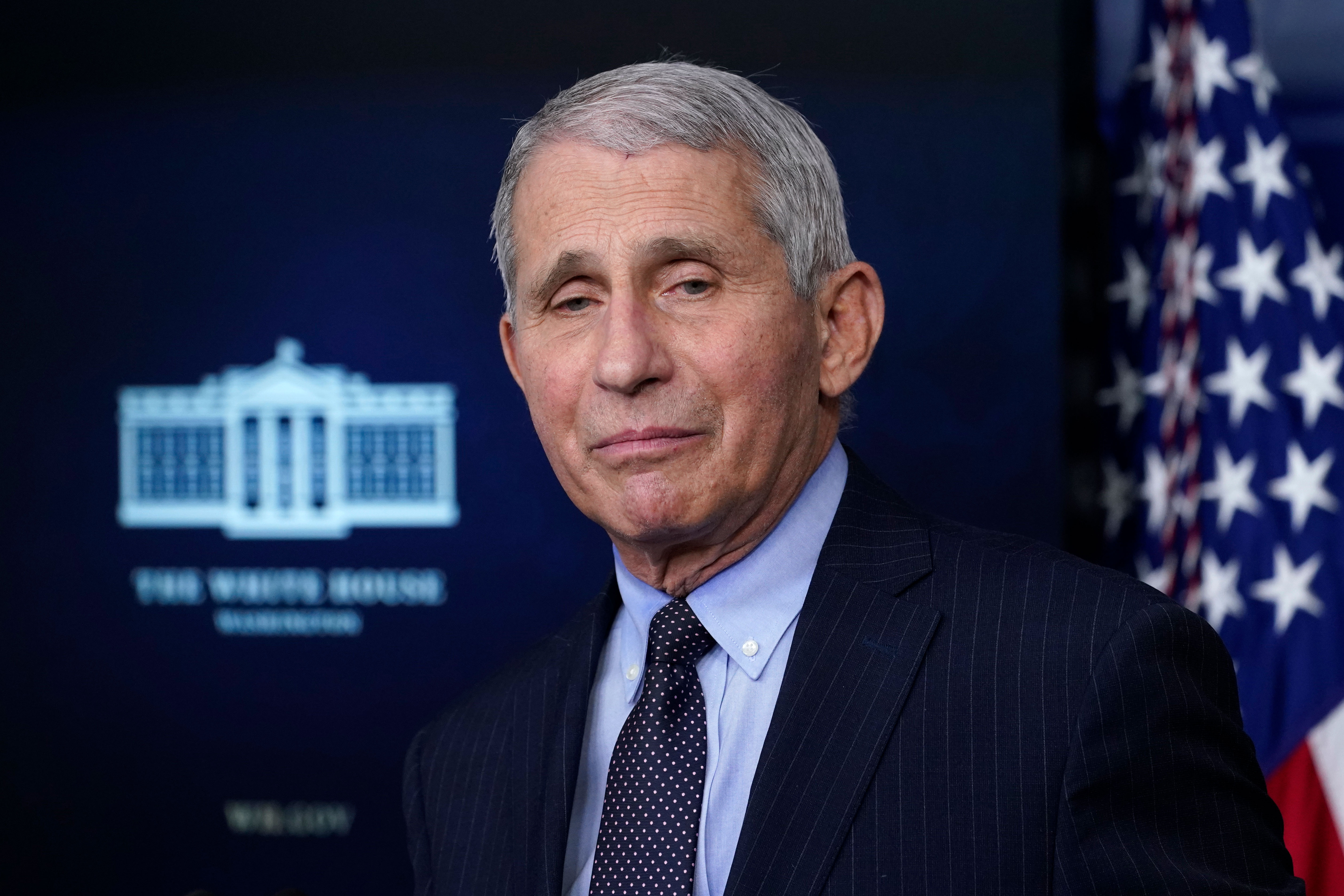 Dr. Anthony Fauci, director of the National Institute of Allergy and Infectious Diseases, speaks with reporters during a briefing at the White House on January 21.