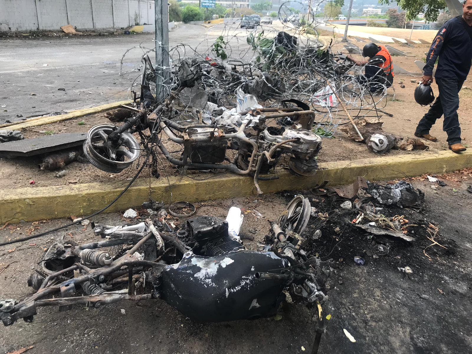 Charred motorcycles in the capital Caracas Wednesday.