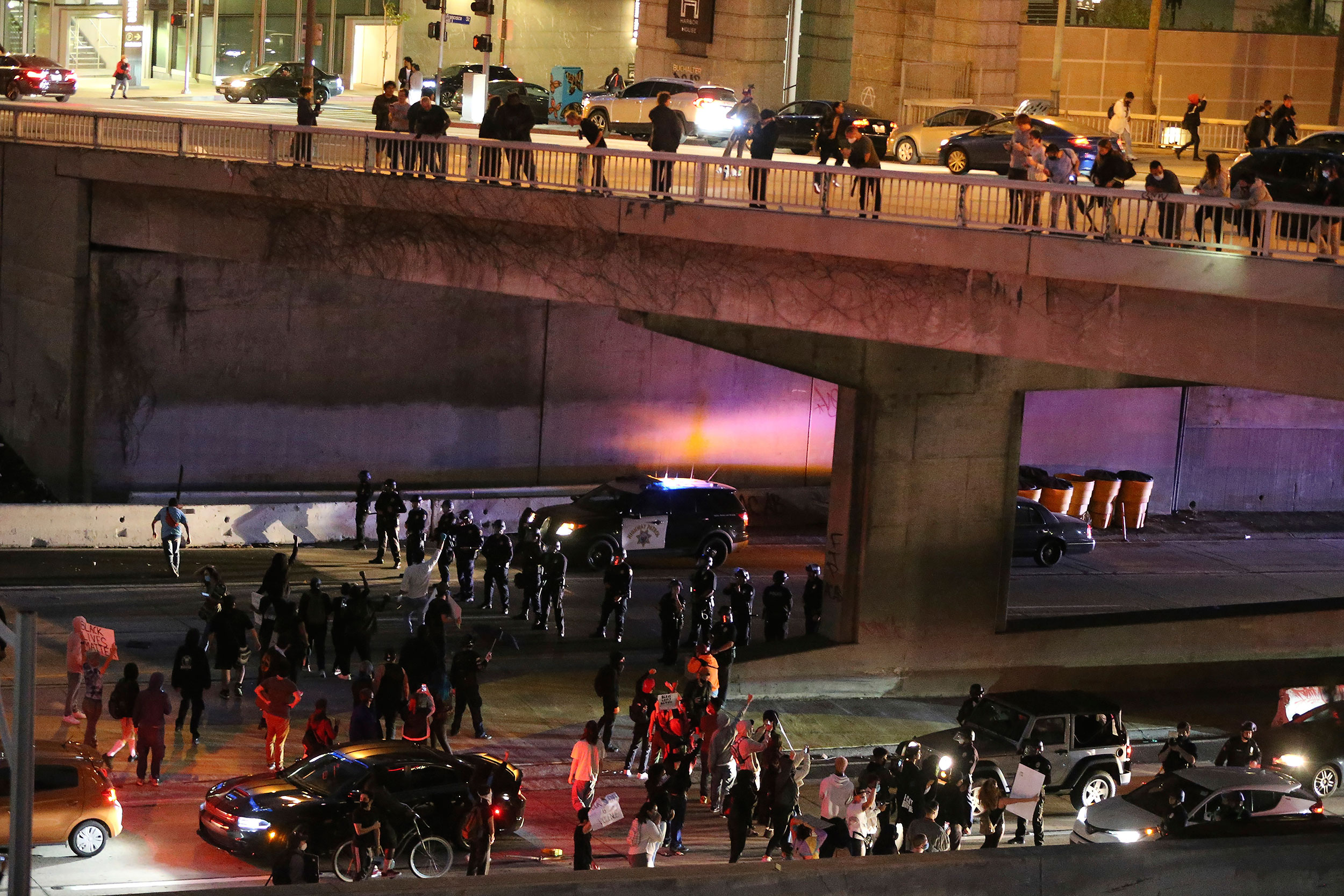 Demonstrators shut down the northbound CA-110 freeway in downtown Los Angeles on Friday.