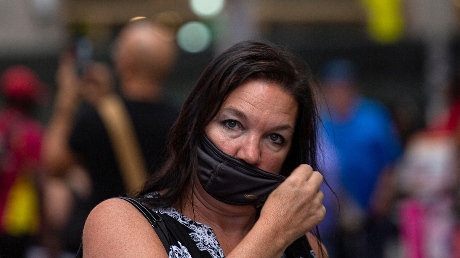 A woman wears a mask in Midtown Manhattan in New York on July 29.