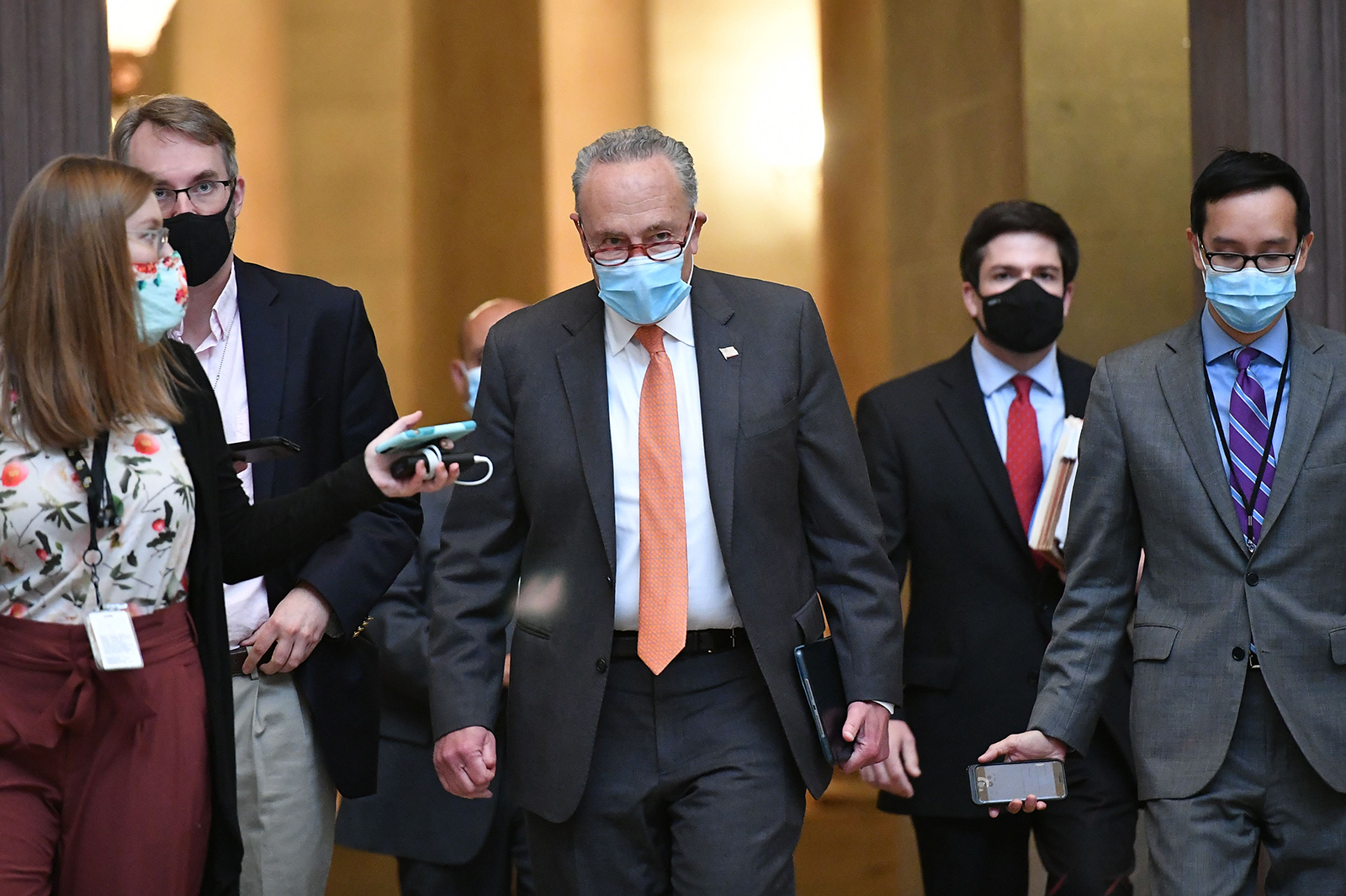US Senate Minority Leader Chuck Schumer, D-NY, makes his way to the office of House Speaker Nancy Pelosi, D-CA, for coronavirus relief talks at the US Capitol in Washington, DC on August 6
