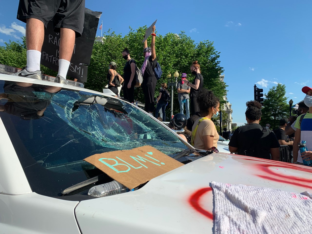 Protesters on top of a vandalized Secret Service vehicle outside of the White House on May 30, 2020.