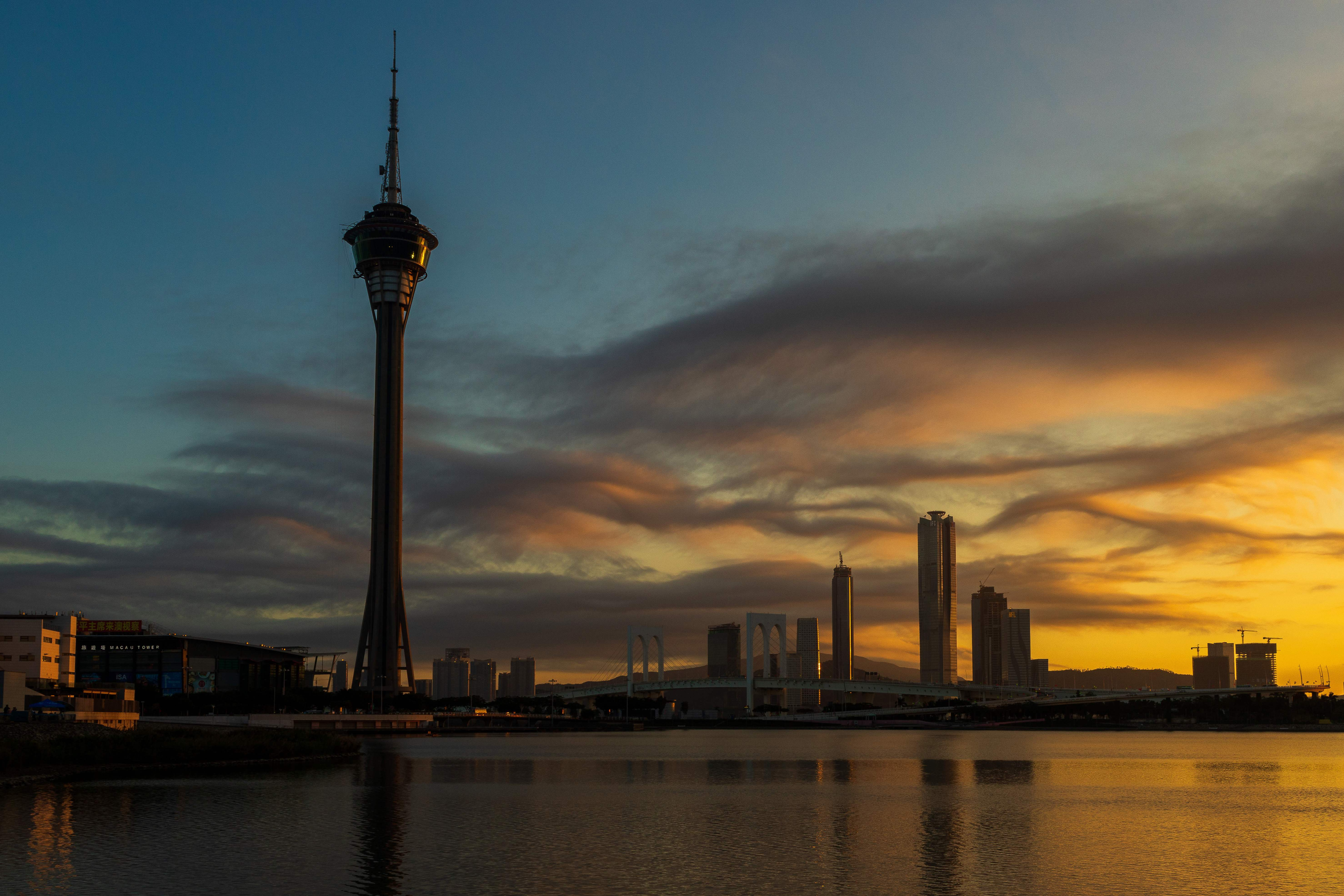 The Macau Tower (left) and the skyline is seen during sunset in Macau on December 18, 2019.