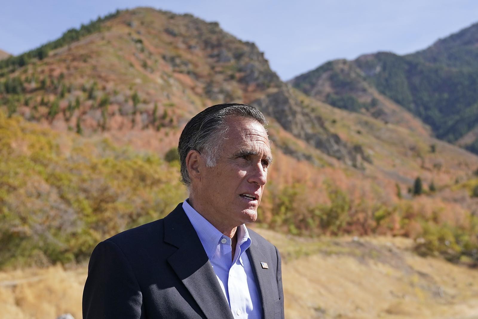 Sen. Mitt Romney, R-Utah,speaks to reporters following a news conference Thursday, October 15, near Neffs Canyon in Salt Lake City.